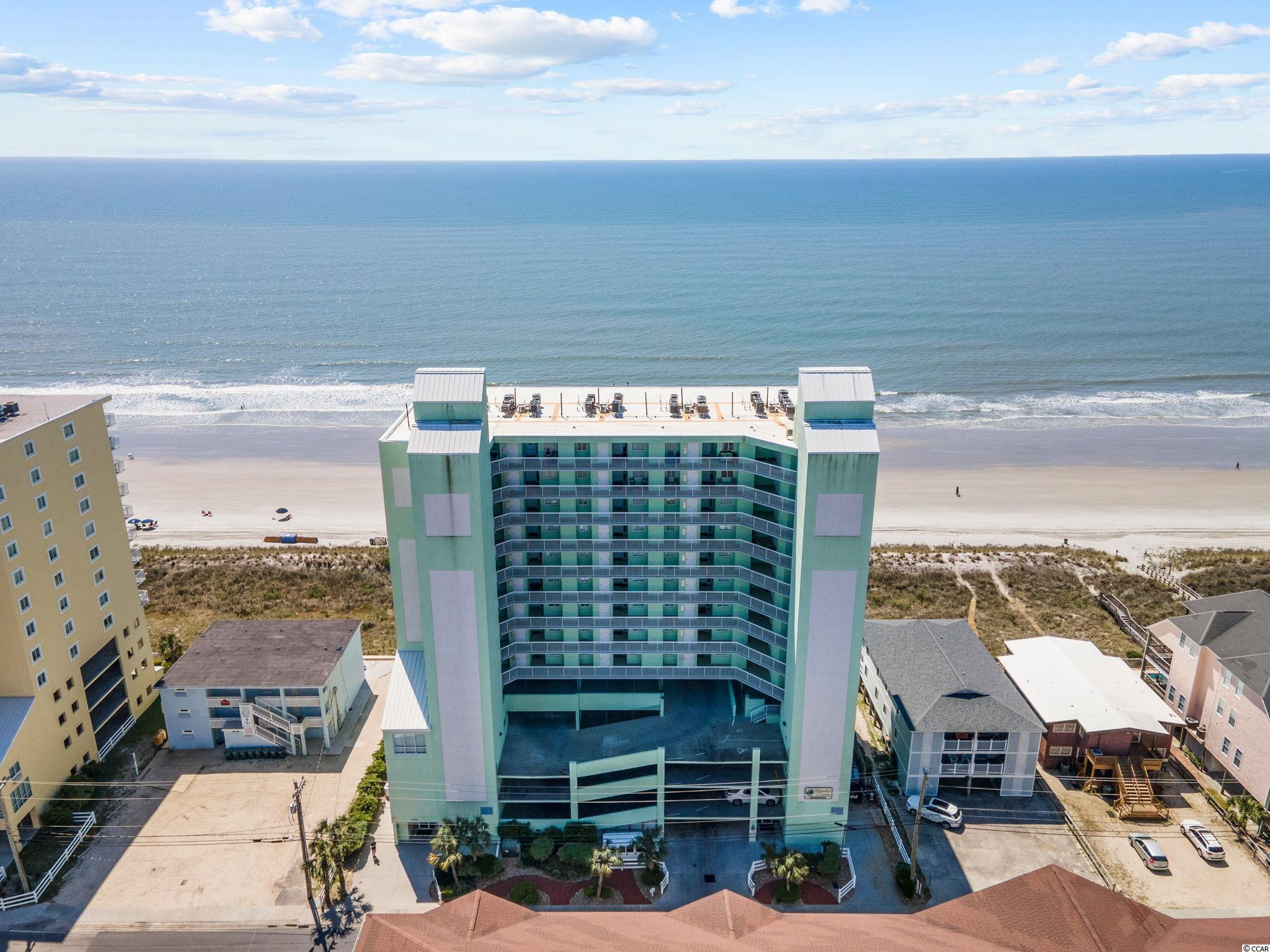 Put your feet in the sand with this spectacular end unit 4 bedroom 3 bath Paradise Pointe oceanfront condo. The WOW factor is the large oceanfront balcony with incredible views of the sparkling Atlantic Ocean. This piece of paradise, that is not on a rental program and only used as a second home, and features carpet & tile flooring, stylish furnishings, ceiling fans, and includes a spacious living/dining area with a sliding glass door that opens up to the wonderful balcony. The cheerful kitchen is equipped breakfast bar, solid surface counter tops, white on white appliances, smooth flat top range, built-in microwave, dishwasher, a side by side refrigerator with ice & water door dispenser, and ample counter & cabinet space. The oceanfront master bedroom suite offers a sliding glass door that opens up to the balcony, walk-in closet, ceiling fan, private access to the spacious master bathroom that presents showcasing a soothing jetted tub, step-in separate shower, a comfort station, and a double-sink vanity. The condo is completed with three additional inviting bedrooms, two full baths, and extra closet storage. This condo affords you easy access to the beach and golfing along with all of the other activities and happenings in North Myrtle Beach & Myrtle Beach including fun eateries, award winning off-Broadway shows, public fishing piers, and intriguing shopping adventures along the Grand Strand. Conveniently located to your everyday needs, including grocery stores, banks, post offices, medical centers, doctors' offices, and pharmacies. Check out our state of the art 3-D Virtual Tour.