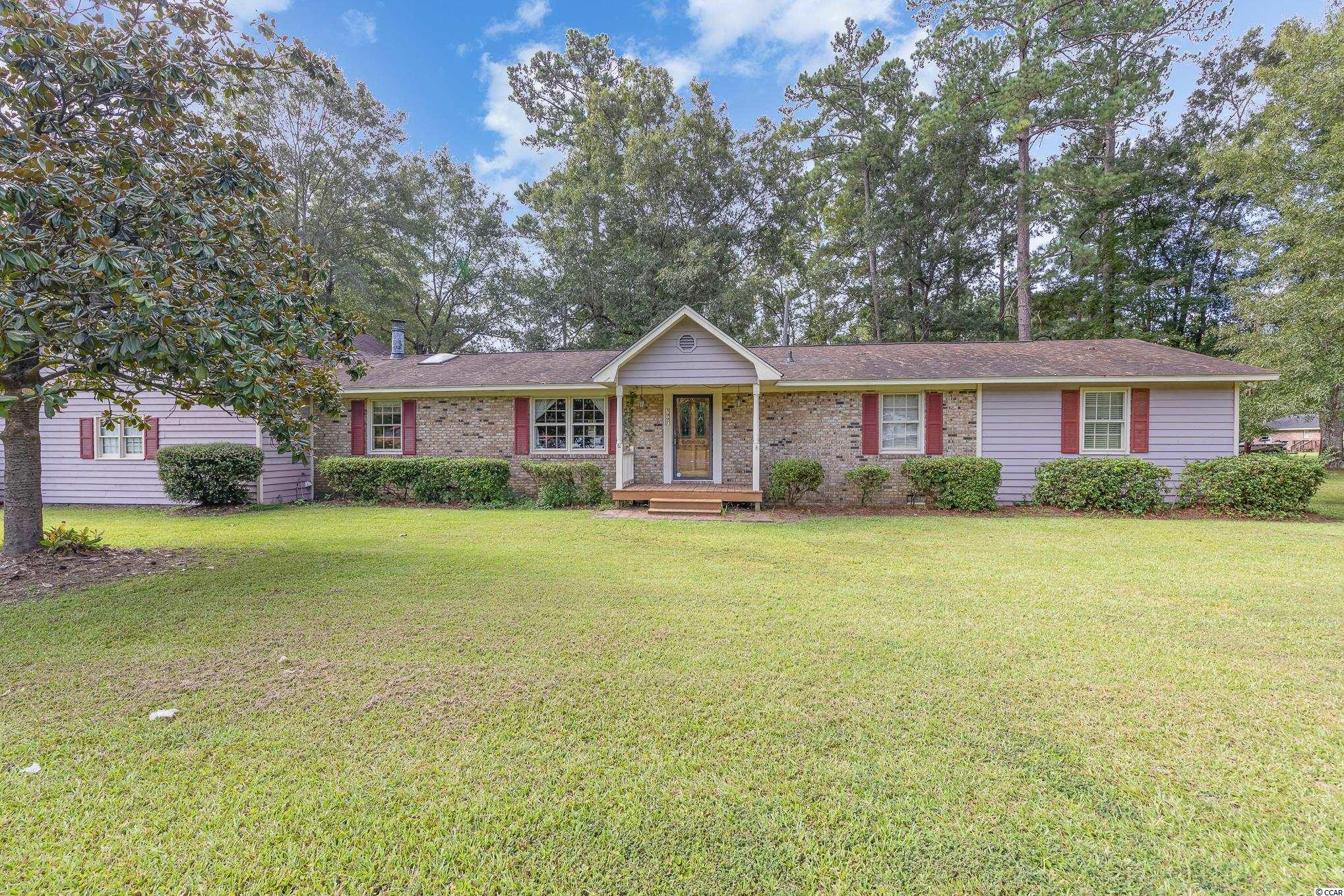 A great opportunity to own a 3 bedroom, 3 full bath home within a short distance of Conway on .66 acres of land and NO HOA.  This home features a large Master Bedroom with Jacuzzi Hot Tub, ensuite bathroom and it's own private entrance, there is a room attached that could be used as an office or turn it into a large Master Closet.  There is another large bedroom above the garage with an ensuite bathroom. The den features a very nice built-in desk and shelving for display and storage with a fireplace.  Step into the kitchen which features a small bar, pantry and plenty of cabinet space.  There is a living room which features beautiful wood paneling and plenty of room for additional entertaining space.  There is a small dining room that could be easily converted into a 4th bedroom that features 2 closets. The home features an oversized garage with a large storage room, new Hot Water Heater, New A/C replaced in Fall of 2020.  The crawlspace has been encapsulated with a dehumidifier.  There are 2 separate outbuildings for lots of storage!!  This home is a must see!!