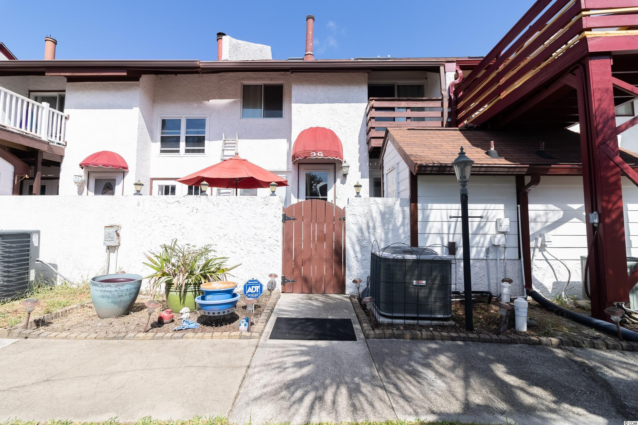 Don't miss out on this incredible opportunity! This beautiful 2 bedroom, 1.5 bathroom home is located WALKING DISTANCE TO THE BEACH with NO HOA and features a bright and spacious floor plan! The open living room features a warm fireplace and lots of natural light! The country kitchen features lovely white cabinetry, custom backsplash, granite counter tops, a breakfast bar, and stainless steel appliances plus a formal dining area! The comfortable master bedroom features high vaulted ceilings, a large walk-in closet, and access to a private balcony! This amazing home also features a large storage building perfect for any extra storage you may need! You will enjoy the spectacular weather and the relaxing patio perfect for grilling out and entertaining! Being in such a great location, not only are you just 1 minute to the beach, but you are also only minutes to Broadway at the Beach, Market Commons, delicious restaurants, shops, and so much more! Book your showing today!