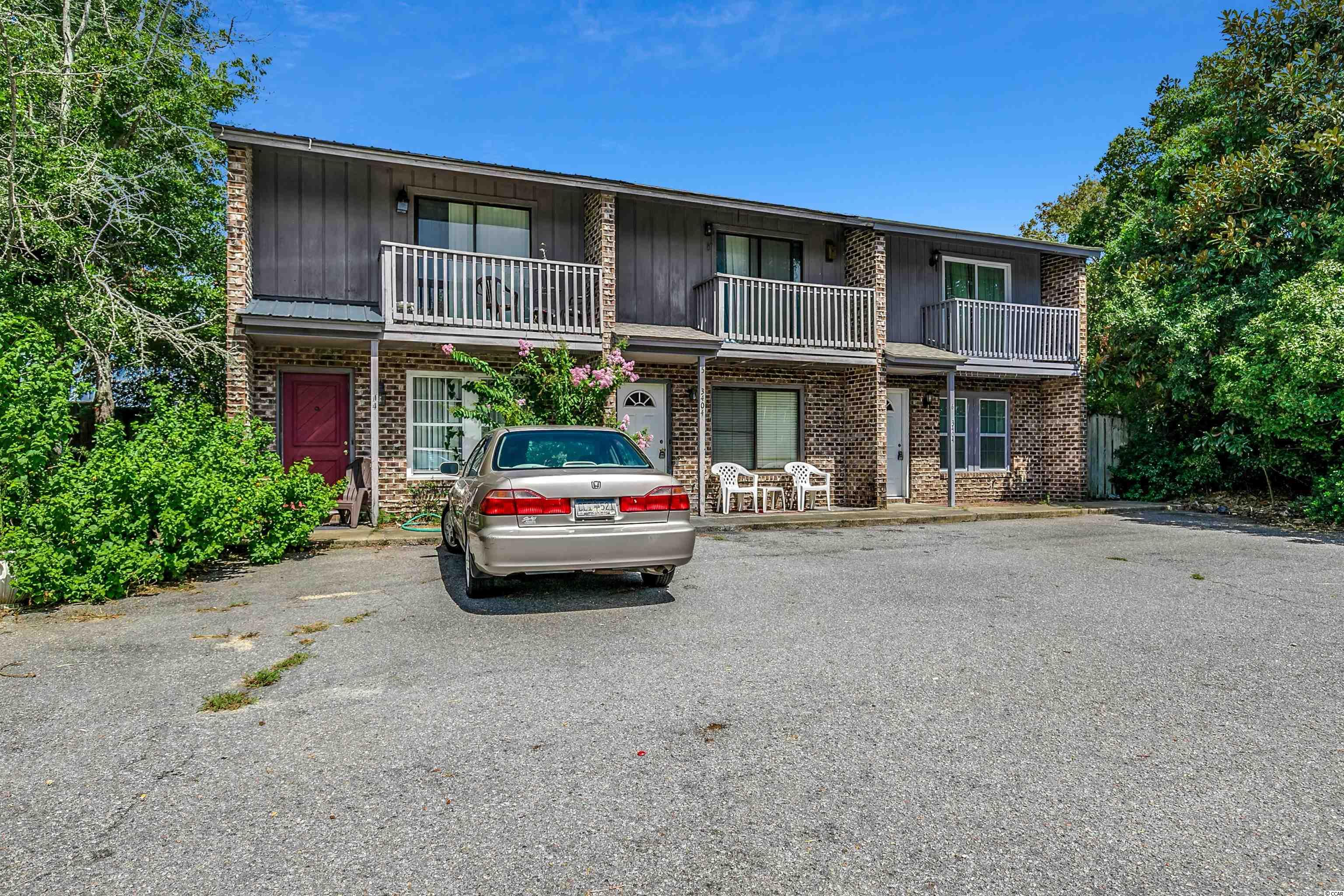 Two level, true townhome in just a few blocks from the beach, beachside of 17 in the Windy Hill section of North Myrtle Beach. Great location, fenced in backyard, nice floorplan. Great living space, upstairs bedrooms, Use as a primary residence, second home or rental. All this and no HOA!