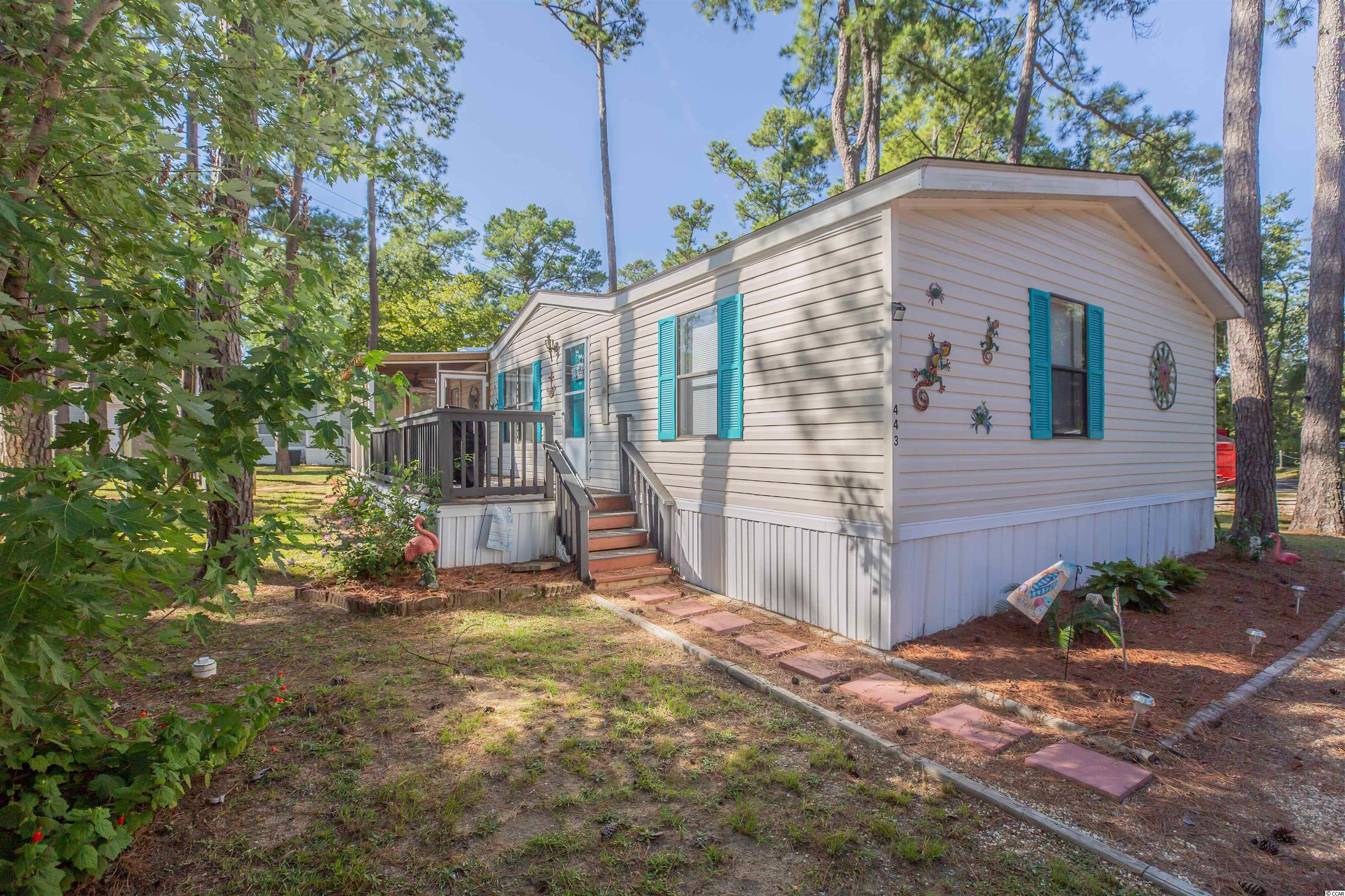 This beautiful 3 bedroom 2 bath double wide home is turn key and ready for an new owner. Home features a new screened in porch with a ceiling fan. Homes comes furnished with the exception of a few items. The roof is only 8 years old and home is on a canal lot! Waterford oaks has a community Gazebo, fishing doc and boat landing. Welcome to our community where you are only a golf cart ride to the marsh and Garden City Beach. With access to the community boat launch you also have direct access to the marsh, as well the ocean with your private boat or canoe.