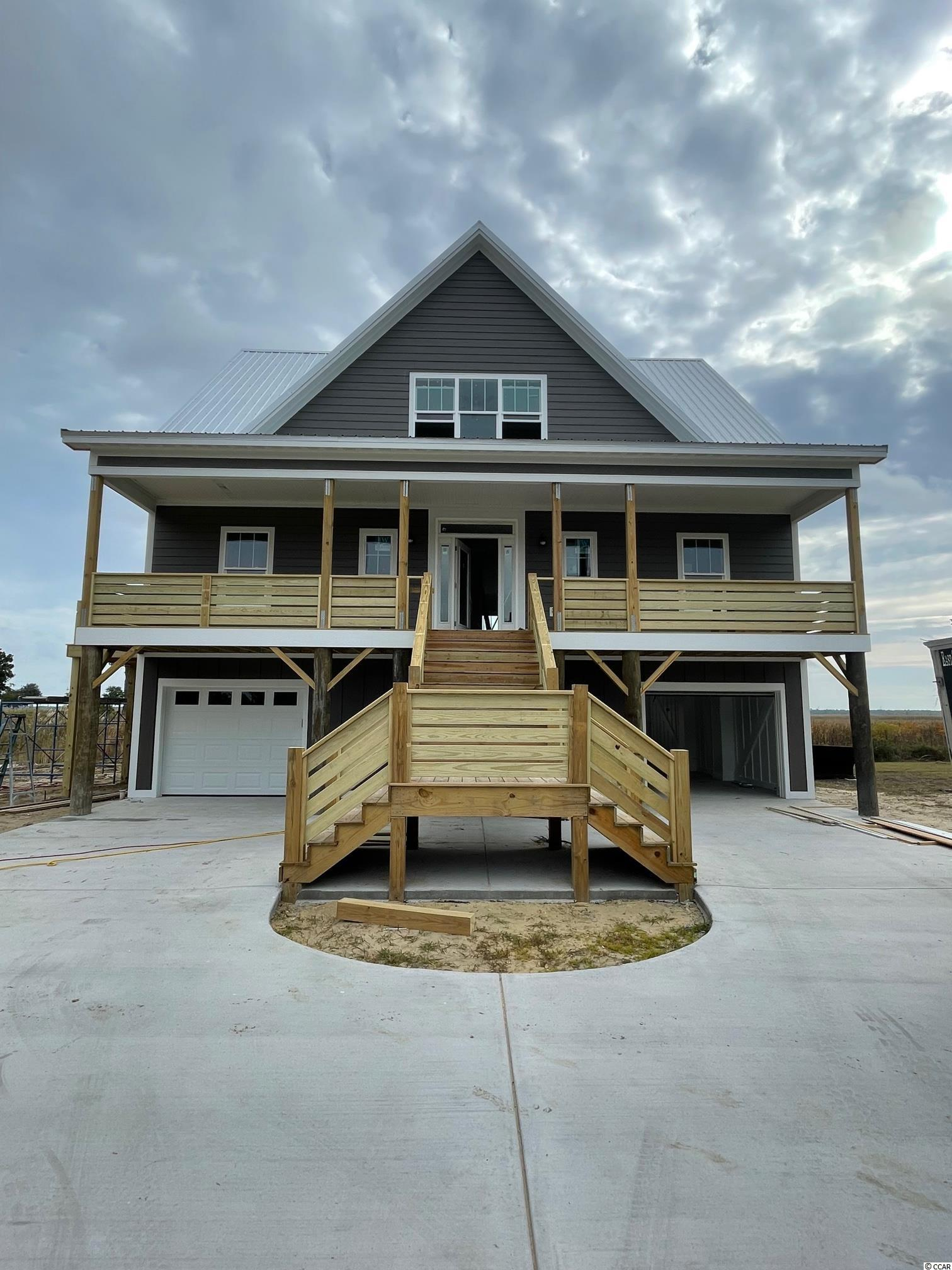 Look no further, Oak Bay Drive is a beautifully designed  home with a picturesque view of the  Winyah Bay and Intracoastal Waterway. This four bedroom, three and one half bathroom, raised beach style home sits on a gorgeous marsh front lot located in the community of The Oaks on Winyah Bay. There are wide decks on both levels providing panoramic views of the Winyah Bay. The primary bedroom is on the main level; 3 additional bedrooms with a den are located on the second level  This waterfront community has amenities which include a pool, hot tub and a Day Dock on the Winyah Bay.  Not only are you 15 minutes from the wonderful beaches on Pawleys Island, you are also minutes from several public boat landings and East Bay Park. Come Make this your forever home, just minutes from the shopping and dining in Downtown Georgetown, and centrally located halfway between Charleston and Myrtle Beach.