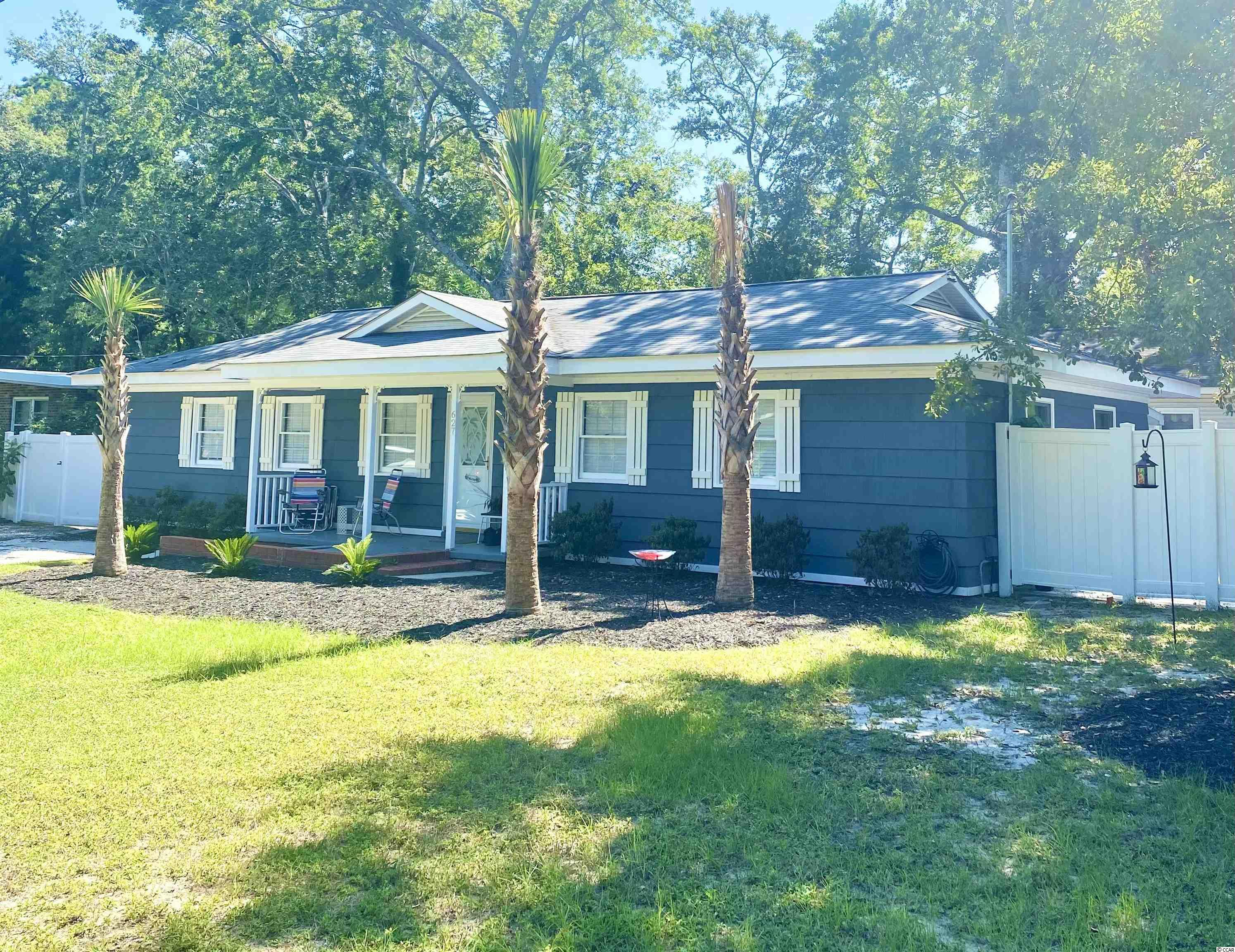 This is your chance to own a gorgeous beach cottage in the popular, family friendly Town of Surfside Beach. This fully furnished immaculate home is move in ready, all you need are your clothes! Located on a corner lot with beautiful trees and new landscaping, this gem is less than a 1/2 mile to the sand. With tons of natural light and an open floor plan, your entire family will love this home! The kitchen offers a large island/breakfast bar, white cabinets and SS appliances. The kitchen overlooks the living and dining areas so your whole family can be together while you are preparing meals. Behind the dining area you will find the laundry closet and also an extra flex space that can be used as a coffee bar area, wet bar, storage, etc. The living room boasts classic cottage style walls and ceilings with a built in electric fireplace surrounded by shiplap. The generously sized master bedroom has multiple windows, 2 closets including a walk in with barn door, a gorgeous ensuite and enough space to create a separate sitting area. The other bedrooms are nicely furnished and equipped with all you need. You will love the hall bath with walk in shower and charming touches. The entire home is tastefully decorated with upscale furniture and finishings. Head out back through the french doors to your fully fenced and private back yard for the perfect relaxation and/or entertainment spot! The backyard has recently been re-done to include a brand new patio area with concrete pavers, new furniture and a hot tub! There is also an attached storage shed and room on the other side of the yard to park your golf cart. This property is located in the award winning St James school district and close to everything including shopping, dining, health care and, of course, the beach.  Don't miss out on this one!