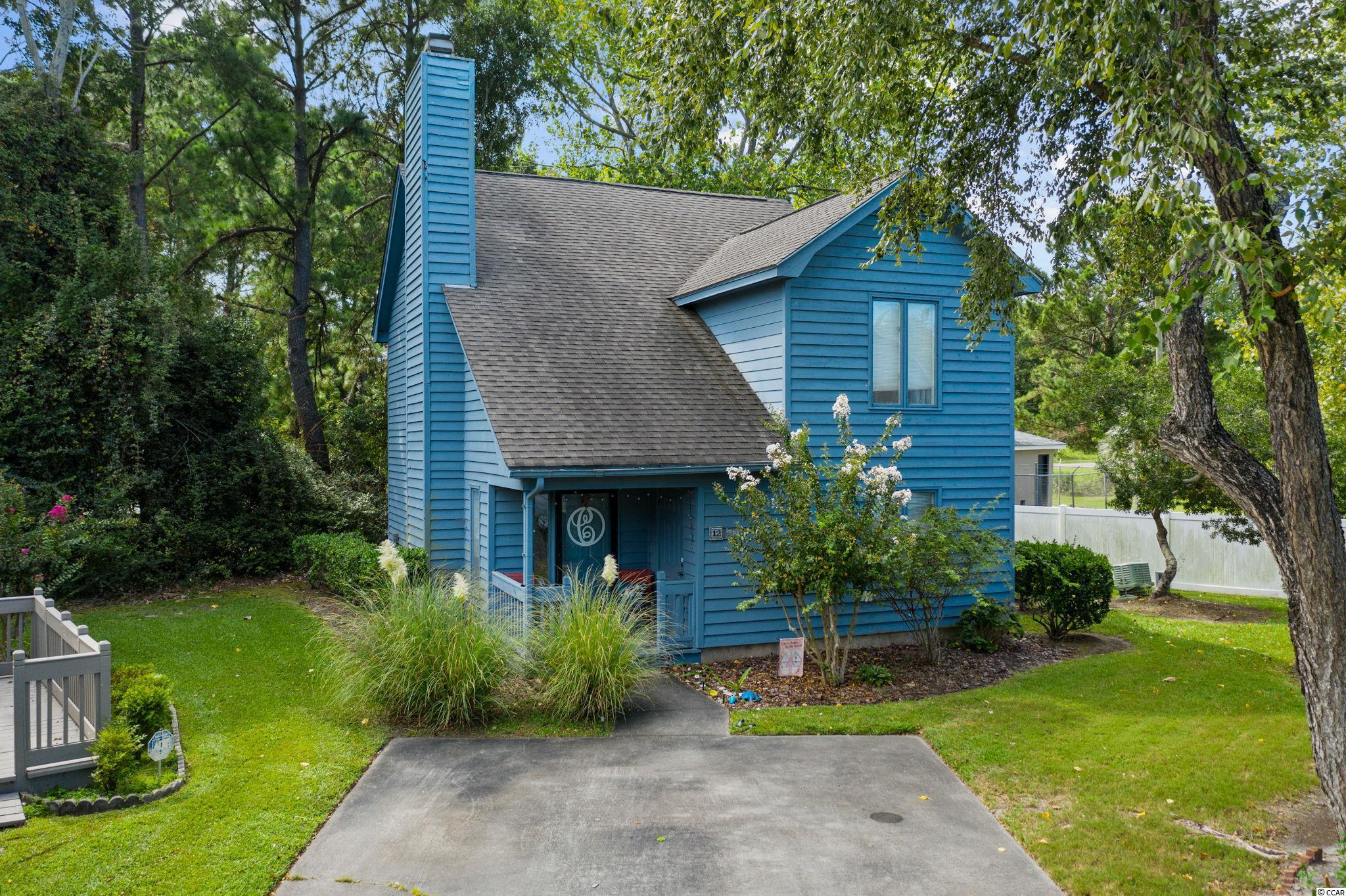 An Absolute Beauty! This gorgeous 3 Bedroom 2 Bathroom property in the heart of Myrtle Beach can be yours for an excellent price. Located in the quiet and charming Foxcroft community, this home is nestled in one of the best locations in the subdivision. Walk into an open living space and feel instantly at home. Vaulted ceilings downstairs, LVP Flooring throughout the living areas and carpet within the oversized bedrooms, this home is the definition of comfortable. A kitchen with a breakfast bar, great sized dining area, fireplace, and an oversized patio make entertaining space possible. The primary bedroom and bathroom finish off the first floor. Oversized primary closet and double vanities in the bathroom as well as washer dryer downstairs! Upstairs you are greeted with two more bedrooms of excellent size, as well as an additional full bathroom for your family and guests to enjoy. This home was extremely well taken care of and it shows! Whether it is an investment property, a vacation getaway, or a primary residence, you MUST come check this home out! Located next to all the entertainment, shopping, and eateries you can handle, being in the middle of Myrtle Beach has it's perks! This home with a 2 Minute drive to the ocean can be yours today!