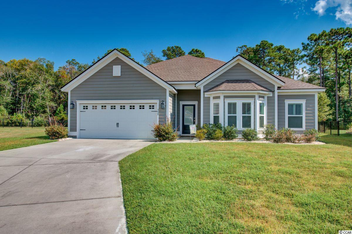 Find your next home right here in Pawleys Island at 352 Southgate Ct! Welcome to The Colony, a coastal community east of Hwy 17 established in 2016 with less than 50 homes. Situated on a cul-de-sac and large wooded private lot. This property is large enough to put in that dream pool you have always wanted! Come inside to an open concept home containing 3 bedrooms, 2.5 baths, and carolina room all on a one level floorplan. Large owner's suite including two closets, soaker tub, shower and double vanity. A spacious kitchen with an eat in area, office space, and a pantry large enough to fit bulk items. This house is truly a gem in Pawleys Island.