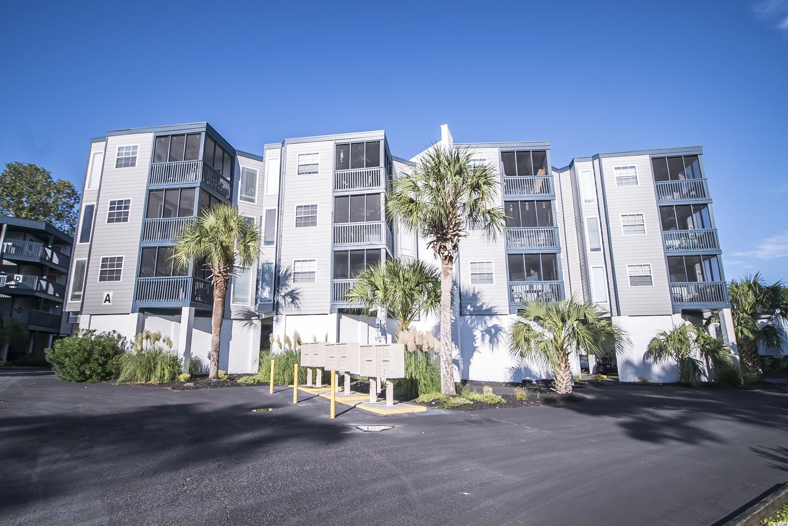 Ocean Greens 2BR/2BA fully furnished condo. Well maintained, nicely decorated and appointed.  Screened porch.  Community pool.  Short drive to the beach!