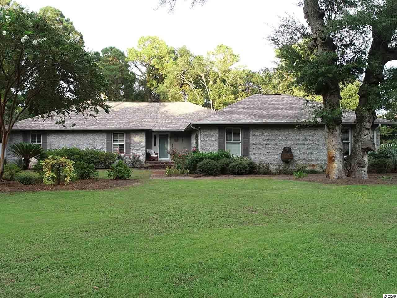 Walking distance to the Beach! The home is located in the well established Arcadian Shores neighborhood. The home has 3 full bedrooms with 1 non confirming bedroom. 2 1/2 Bathrooms that have been remodeled. All Brick home, ranch style (all on one floor). Hardwood flooring throughout the home. The Livingroom has a true wood burning fireplace, Dining Room and Sunroom overlooks a koi fish pond and live oak trees in the back yard which is entirely fenced in and includes a spacious storage facility for your yard equipment and or golf cart. Plenty of room in the Carolina room for family and friends to gather. Upgraded appliances, breakfast room off the kitchen. Plenty of storage in the 3,098 sq. ft. home. Plenty of room to build a pool on this .46 acres too. There is a private 7 acre lake at the end of the street to enjoy. Tucked away from the tourist or traffic but close enough for shopping and restaurants. Property taxes in Horry County differ between primary home and secondary home.