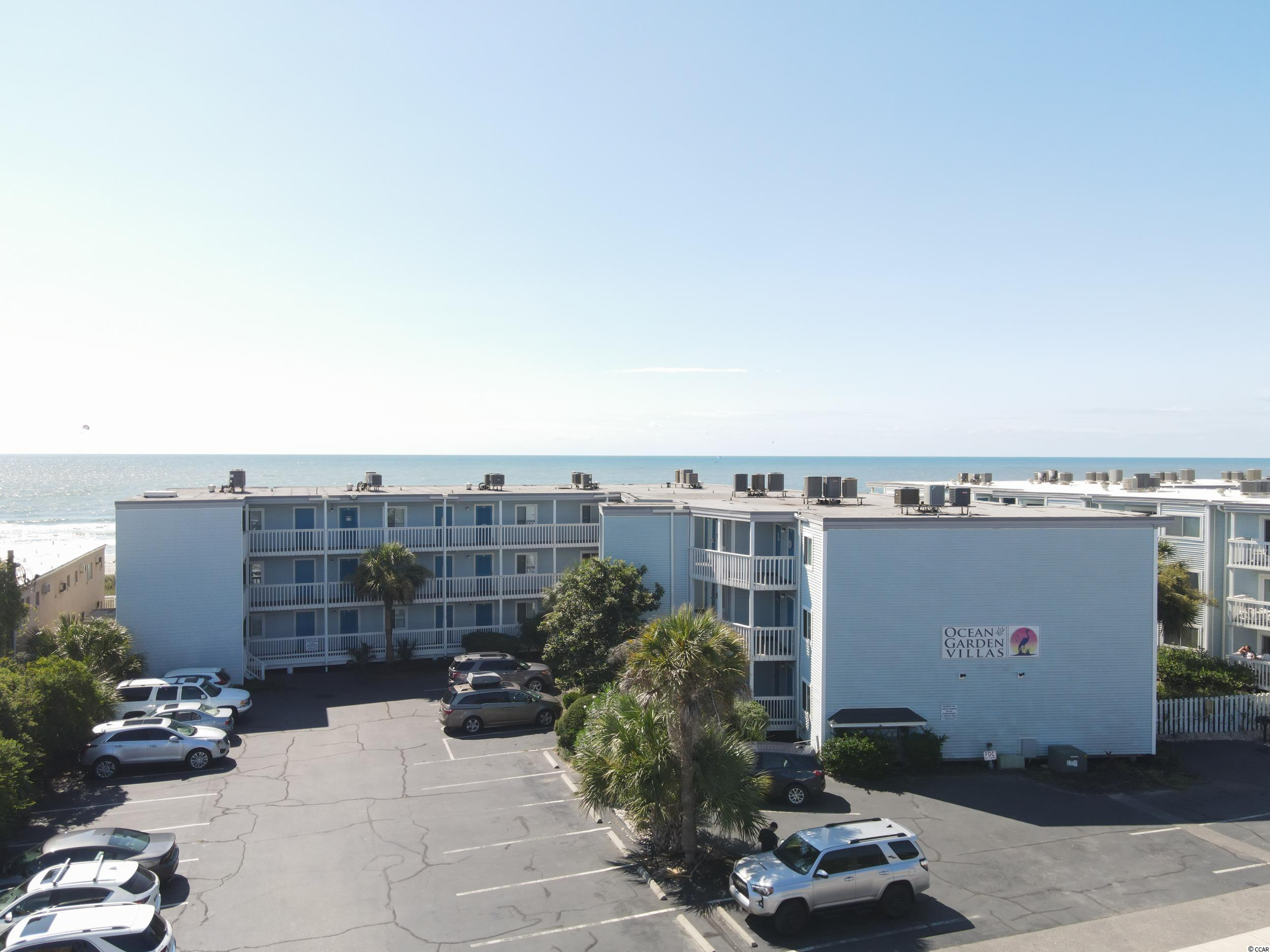Put this adorable 2 bedroom 2 bathroom oceanfront condo on your list to see!  What I love about this unit is the private balcony it offers so it feels like nobody is on either side of you!  There is no elevator in this building! This second floor unit boasts all black kitchen appliances, a stackable washer/dryer in the owner closet inside the unit, laminate floors with carper in the two bedrooms, a pullout sofa in the living room for extra room to sleep, and the owners put in a window seat in the master bedroom with storage.  The condo has been painted with fun beach colors and is ready for its new owners to make it their second home beach get-a-way or rental. Don't forget to step out the unit and look inside the separate owners storage area for beach chairs and other items!