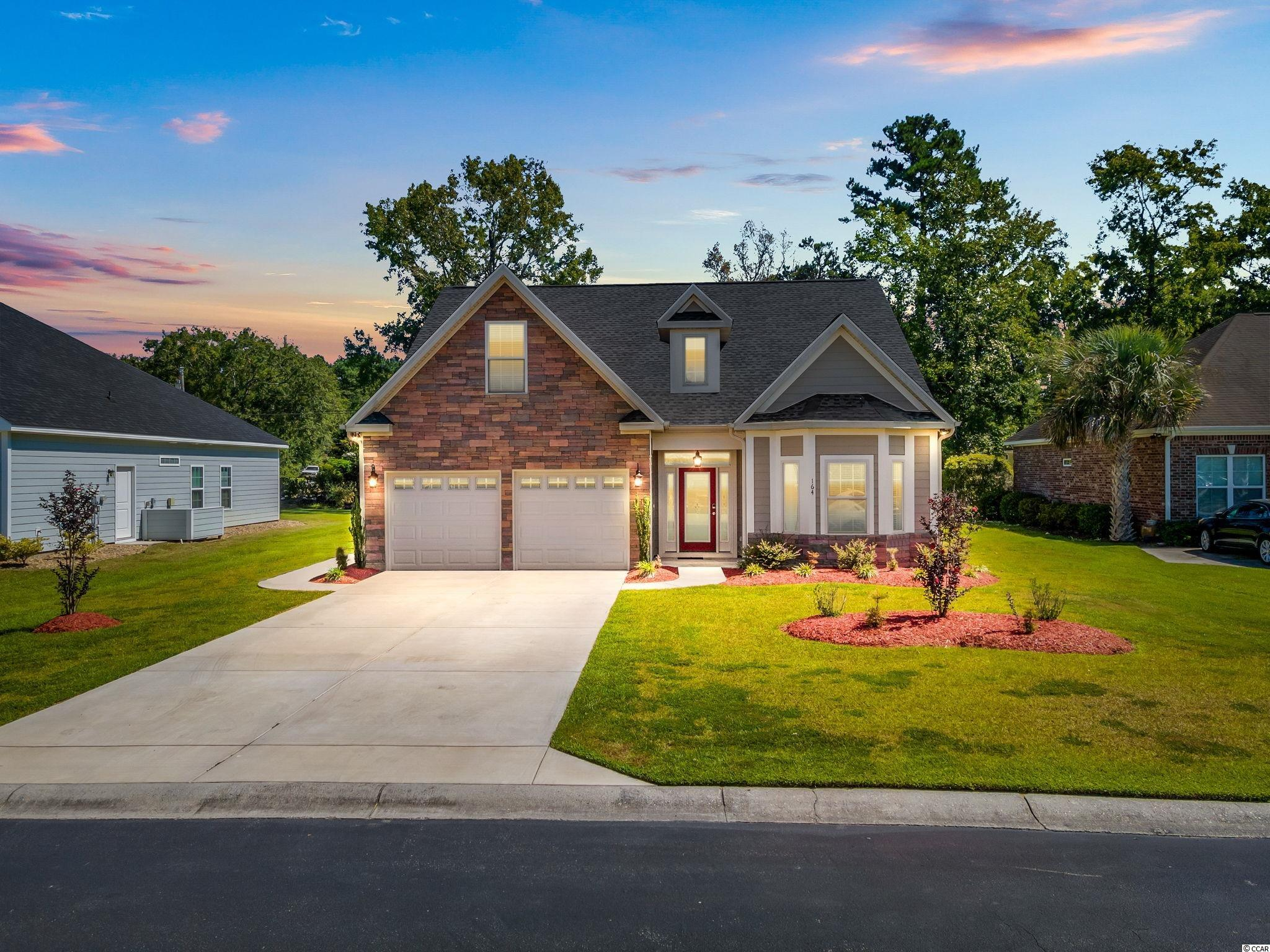 This 3 bed, 3 full bath with bonus room~ custom home is located in the prestigious and private community of Windsong. Minutes from Historic Little River Waterfront, along the Intracoastal Waterway and from Calabash and the beaches of Brunswick county. Carefully designed and finished by it's one owner since completion in 2019. You are welcomed into the foyer with 18 ft. cathedral ceilings and an abundance of light that flows through the entire home, an open floor plan with large, arched windows, detailed trim and double panel doors throughout.  Each of the bedrooms have large closets and ceiling fans, ceiling fans in every room including the primary suite, two in the living area and bonus room. The large primary suite with double tray ceiling and walk in closet includes an en suite with double sinks, a custom tile shower with glass doors and a whirlpool tub.  There is plenty of space in the living area for entertaining as it is open to the kitchen equipped with top of the line GE SS appliances, granite counter tops, plenty of storage and counter space. From the kitchen you can easily serve to the dining area or the grilling area on the patio outside. Upstairs is a never used bonus room and full bathroom, waiting for you to make it your own! No detail spared in this space either! Notice there is not a straight edge in the house,  all rounded corners, even the garage. Every drawer and door in the house has the soft close feature. The tile is large plank ceramic in a lovely neutral tone sure to match all. Smart home features include a security system with cameras including, motion detection, electronic keyless entry, thermostat.  Don't wait on new construction, come see this turn key home today!