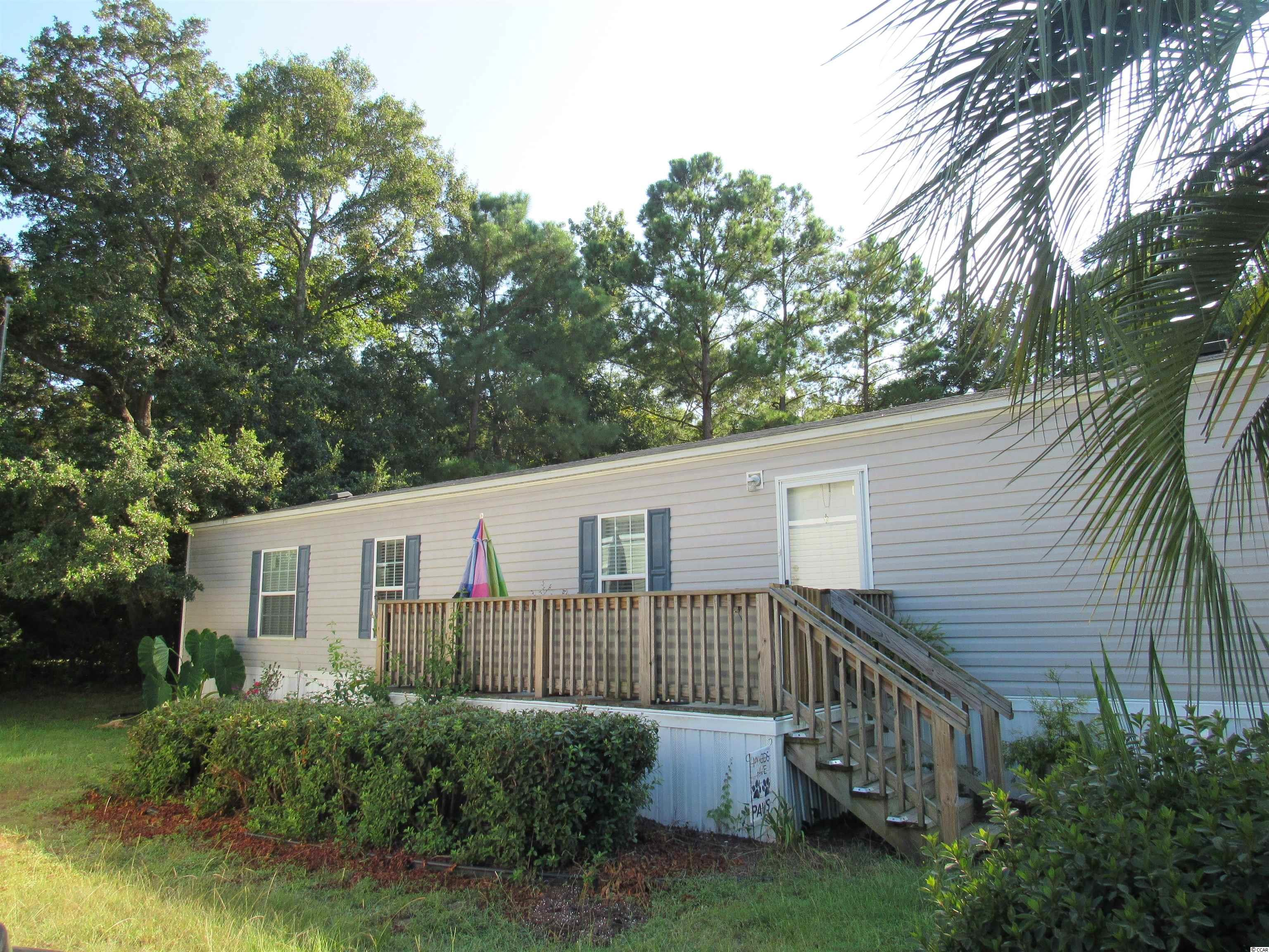 Live in the heart of Murrells Inlet! Your new home is only 6 years old, has 2 bedrooms, 2 baths and features a split bedroom floor plan with an open layout.The kitchen overlooks the living area, has plenty of counter/cabinet space, a breakfast bar and double stainless steel sink. The separate laundry room is just off the kitchen and has a full sized washer and dryer. Your master bedroom is spacious and private with an en suite bath. The second bedroom offers it's own privacy on the other end of the home with a full bath just around the corner. And comes partially furnished! The living room is cozy with plenty of room for everyone! Outside are newly landscaped flowerbeds and an oversized front deck-perfect for enjoying the sunshine! Key Largo is a quiet community within walking distance to the MarshWalk and a short golf cart ride to fine waterfront dining and entertainment! This home would also make the perfect vacation home.....schedule your showing today! Home is on leased land.