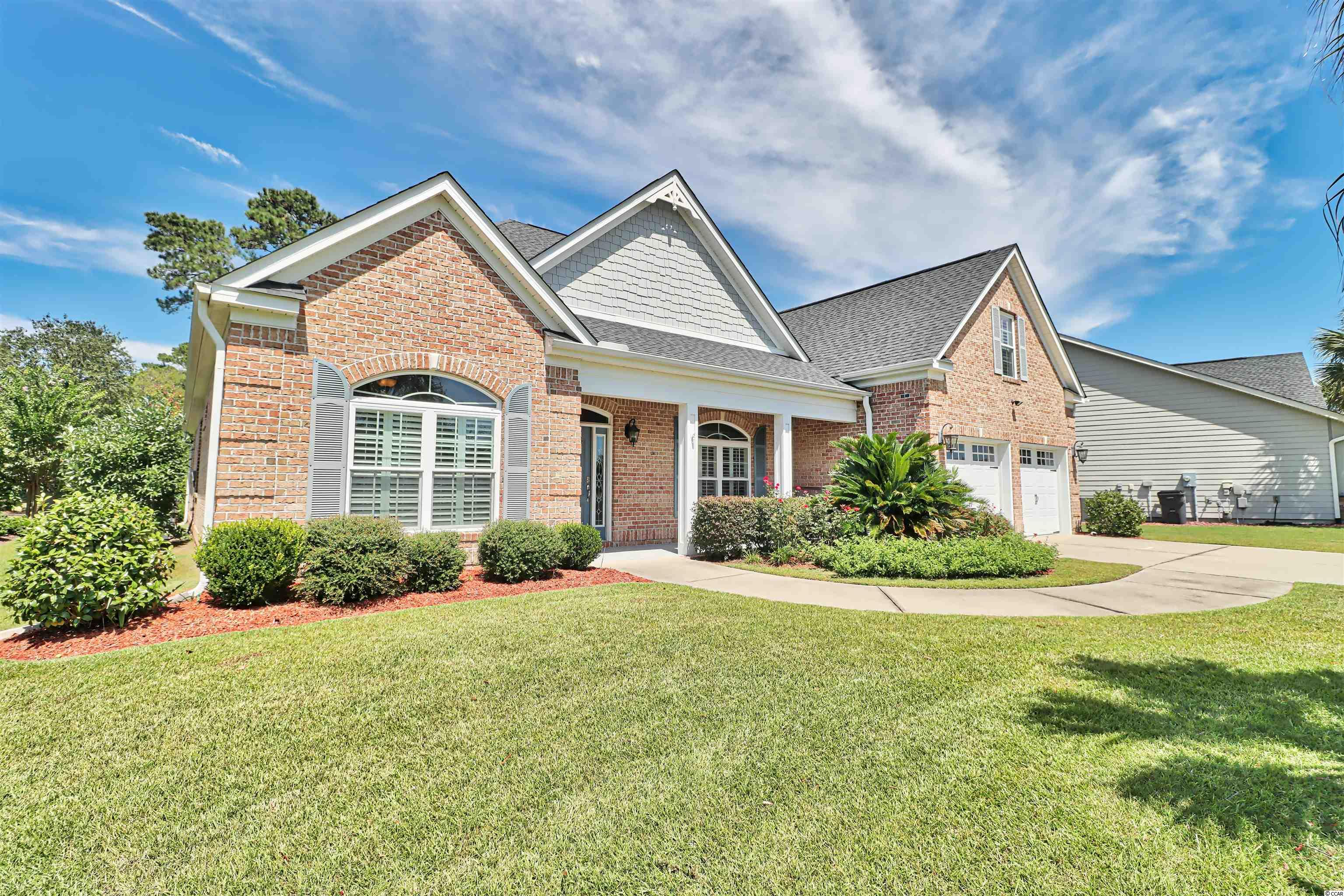 """This beautiful 4 bed/3 1/2 bath custom built home sits on the 16th fairway of the International Club of Myrtle Beach and delivers that """"WOW"""" factor.  Just 2 miles from the ocean, 20 minutes from Myrtle Beach Airport and 90 minutes to downtown Charleston; This custom open concept design allows you to see from the front door to the back porch and on to the golf course unobstructed.  Attention was given to every detail from the Brazilian Cherry Hardwood floors through out to the wainscoting in the formal dining room, foyer, and family room to the crown molding in every room including bathrooms.  The kitchen was designed by a gourmet chef so not only is it stunning to eye but highly functional when preparing meals and entertaining large groups.  Stainless appliances along with 2 large islands and walk-in temperature-controlled Butler's pantry provide a great deal of function and space for storage, cooking and prepping.   As you navigate through the 5,000+ square feet, you'll find large spacious rooms including a Family room, formal dining room, a large Carolina room, 3 main floor bedrooms and an upstairs bonus room / bedroom.  There are double trey ceilings in the dining room, family room and master bedroom.  The expansive screened in back porch has a knotty pine ceiling and 2 1/2-foot knee wall.  Double ceiling fans and pull-down shades make this space enjoyable year-round.  A custom outdoor kitchen complete with a granite counter top,  stainless refrigerator, sink and natural gas grill add to the entertaining possibilities. In addition, a whole house natural gas generator provides continuous power for those unexpected emergencies.  Simply too many extras to list. This is a """"MUST SEE""""!"""