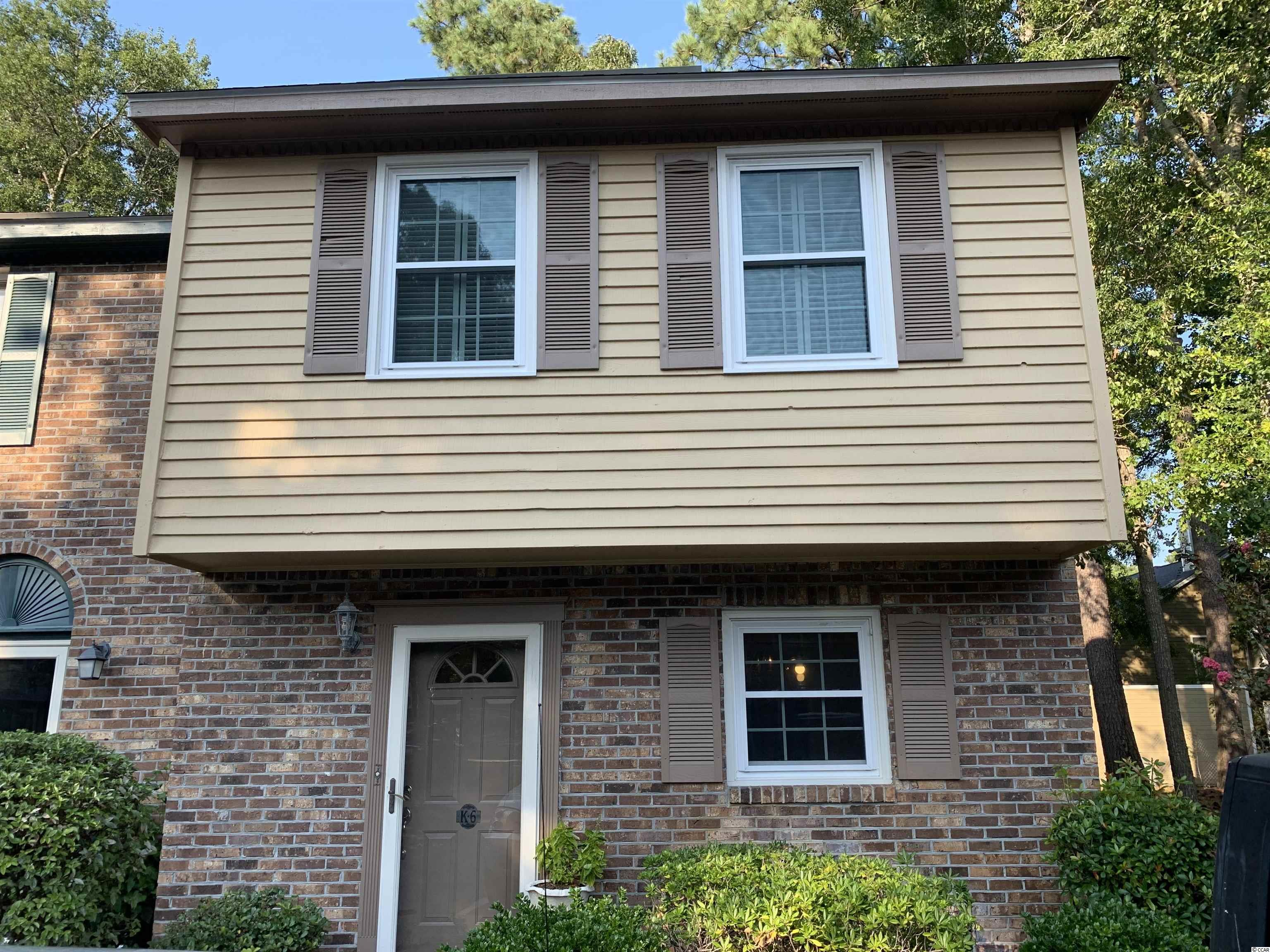 Hidden treasure...this 3 bedroom 2.5 bathroom end unit located in the much desired neighborhood of Carolina Ridge features a large open living area with plenty of natural sunlight, custom made plantation shutters and drapes, hard wood flooring throughout, a wood burning fireplace and half bathroom. The kitchen is equipped with plenty of cabinets for storage, corian countertops, tile backsplash and SS appliances.  Relax and enjoy your private fenced in patio, which includes an attached storage closet for your beach chairs or the amenities that include your community pool, playground, tennis / basketball courts. Upstairs you will find the 3 bedroom and 2 full baths.  Carolina Ridge is minutes away from the beautiful Atlantic Ocean, shopping or dining.