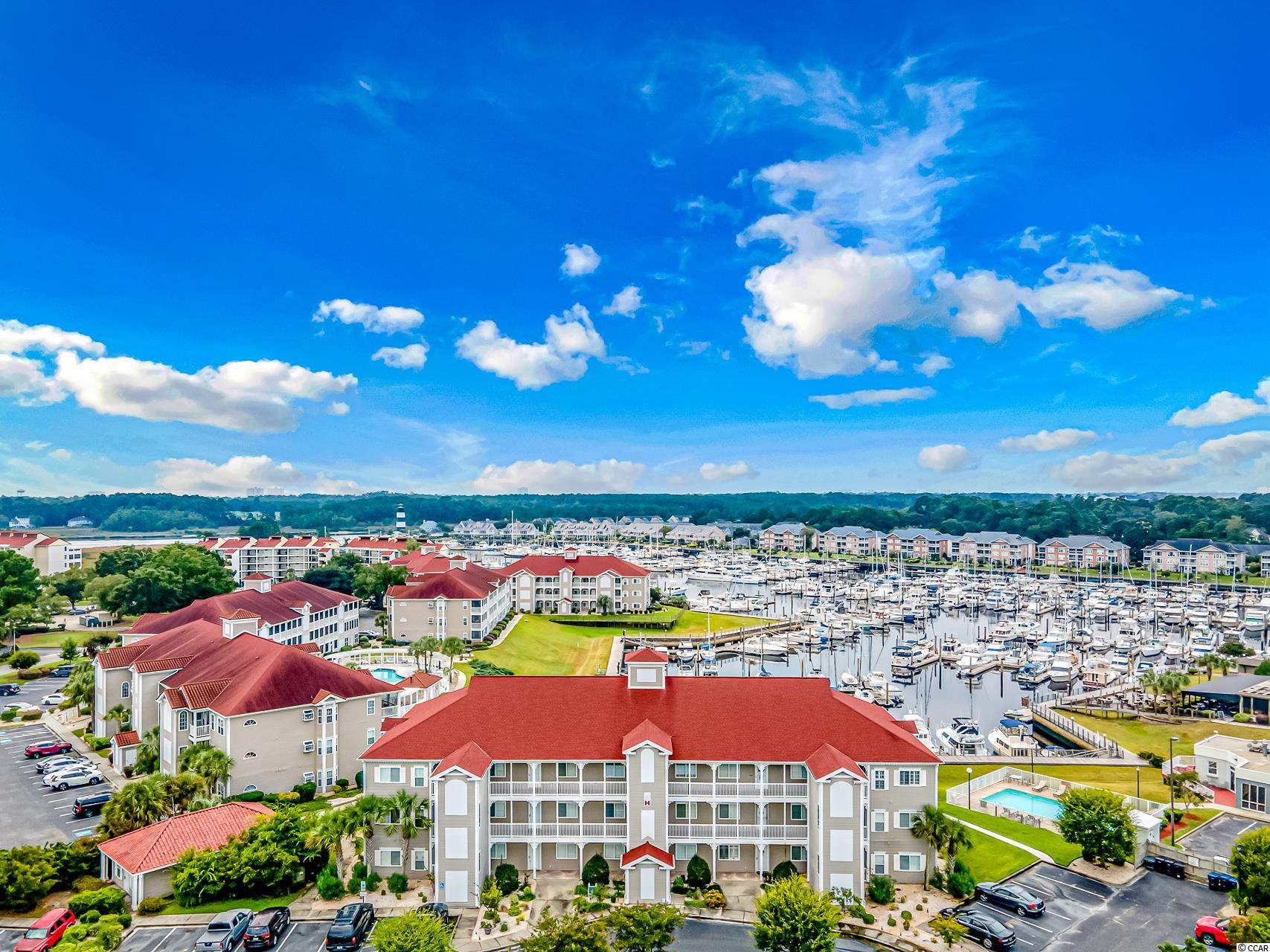If you've been looking for a fully furnished first floor condo in Little River with gorgeous Intracoastal Waterway and Marina views, look no further. This fully loaded condo is immaculate and is priced to sell. The property features upgraded flooring, updated kitchen with granite counters, open concept and more. All of the bedrooms are spacious and the bathroom features tile floors and large walk in shower. Off of the living room is a huge screened in porch overlooking the marina! You can walk right off the porch to the water! To top it off, the HOA fees are very reasonable. You can't beat the price and location. This one won't last long. Better hurry!