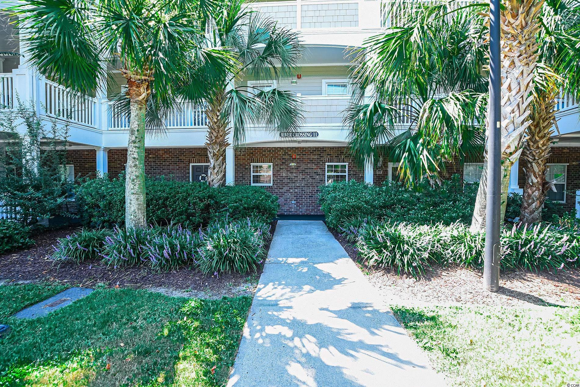 Welcome to River Crossing a gated Barefoot Resort community! This fully-furnished 2BD/2BA  condo has been beautifully maintained and ready for a new owner. The balcony offers tranquil views and you will love the open flow of the unit. Enjoy your the community pool along with all the amenities that come with the ownership of this great unit. You will become part of the Barefoot Resort community which features four golf courses, , access to the private oceanfront beach cabana with a seasonal shuttle, the large saltwater pool at the Towers. the marina offers great restaurants, and if this isn't enough right across the swing bridge you will find Barefoot Landing filled with great eateries, specialty shops and seasonal entertainment. What a great place all located on 15,000 luxurious acres