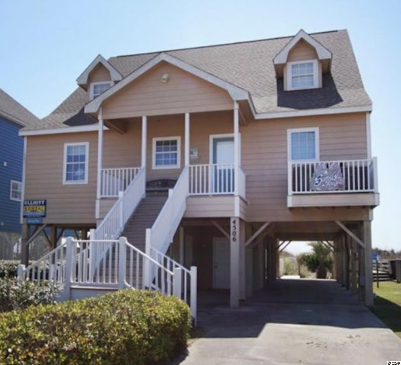 Oceanfront Investment in the family friendly  Cherry Grove section of North Myrtle Beach!  This spacious direct oceanfront home features 6 bedrooms and 6 full bathrooms , wood floors throughout with tile in kitchen and baths. You will love the soaring ceiling in the oceanfront living room.  Large fully equipped kitchen with granite counter tops, 2 refrigerators, butlers pantry, breakfast bar and eat in dining area.  Oceanfront master with new french doors leading out to oceanfront deck. Enjoy the afternoon on the back deck while taking in the salty air and overlooking the sparkling ocean or take a walk down the private wooden walkway to beach .  There is plenty of space for everyone at Sandy Toes, perfect for an investment or vacation home. Home was recently renovated by expanding 2 of the bedrooms, HVAC in 2020 and roof in 2016.  has Don't miss out on this one , it won't last long!
