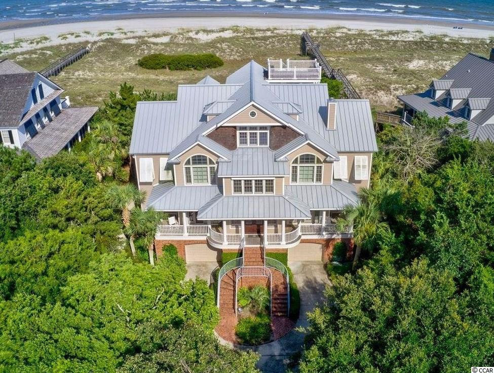 PRINCE GEORGE - Stunning Ocean Front home in the exclusive gated community of Prince George on the south end of Pawleys Island. This 7 Bedroom, 8.5 Bathroom home has something for everyone, even a pool! With the size to accommodate family and friends, room to gather and quiet cozy nooks to relax, it really does have it all. This inverted layout has a grand entrance into the guest level as well as an elevator to each floor. Off the foyer are 5 large guest suites with private baths, a guest kitchen, full laundry with an additional full bath and a guest living room. Three of the guest suites have ocean views and each suite has walkouts to wrap around porches. On the Main level you have both a formal dining area and an ocean front dining space off the recently renovated kitchen. Off the kitchen is an inviting den, sunroom combo and a large walkout deck overlooking the pool, hot tub, and the Atlantic. The Master suite is a true retreat, featuring a walk in shower, jetted tub, huge walk in closet, private laundry, sitting room and even more ocean views. The third level features another guest kitchen area, bedroom number 7, an additional bunk room, full bath, larger living space, formal office and lots of attic storage. The tour would not be complete without a trip on the roof top deck to enjoy miles of panoramic views of coastline, marsh and more.