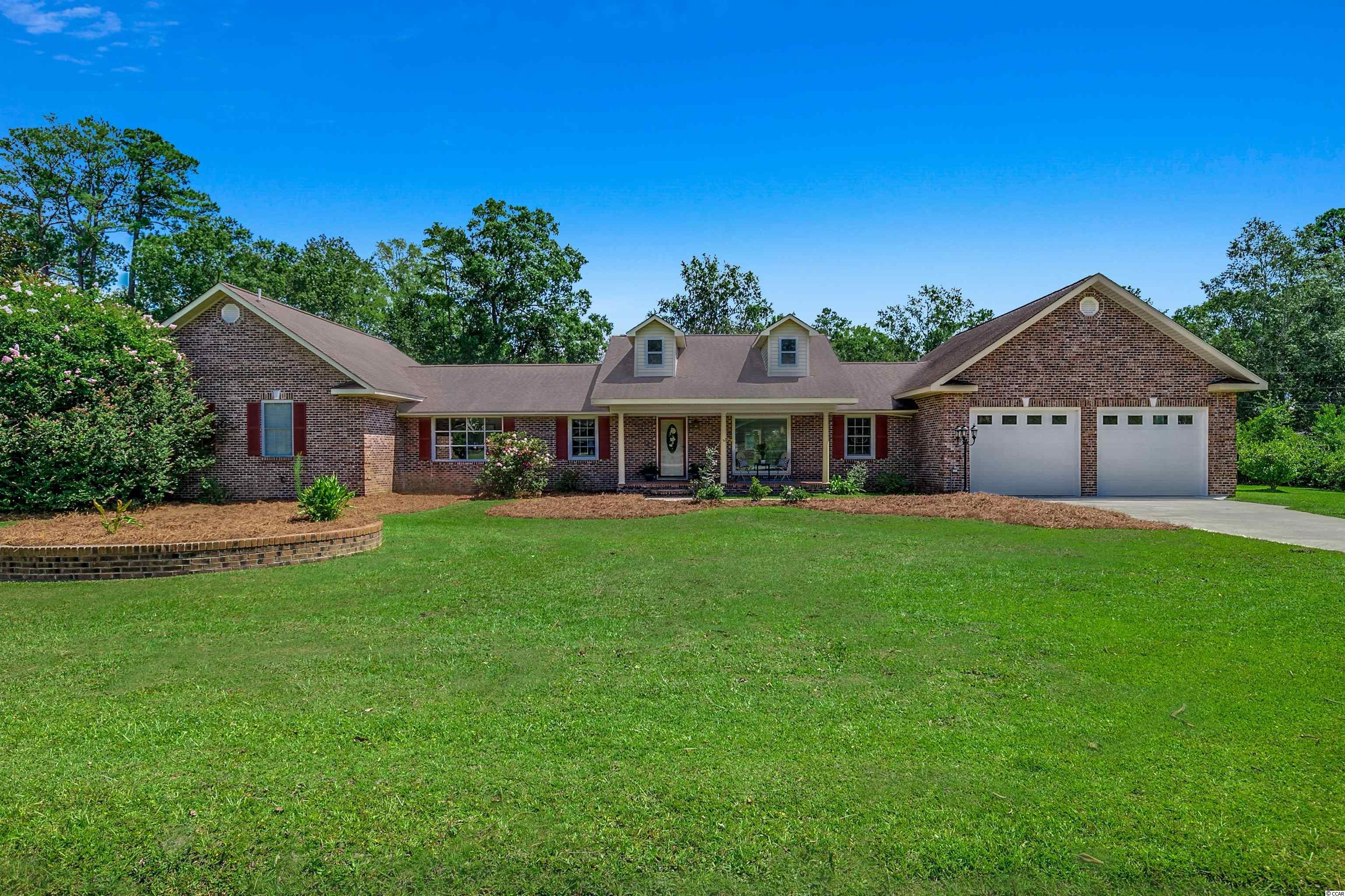 Come enjoy the freedom of having NO HOA at this lovely home located in the peaceful community of McClary in Georgetown! This low-country-style home sits on approximately two acres of land. It was built-to-last with an all-brick exterior and a raised concrete foundation. This one-of-a-kind home is being offered fully-furnished. It has been tastefully decorated with coastal artwork, and the entire home has been freshly painted. When you arrive, you will see a big southern front porch! This is the perfect place to sit back and enjoy your favorite ice-cold drink while you read a good book. As you walk into this beautiful home, you will see a real wood-burning stove and a large living room where you can cozy up with all your loved ones in the colder months. All the main living areas feature durable ceramic tile floors. The kitchen has been completely remodeled! Corian countertops were added along with a custom backsplash and gorgeous cabinets. There is a pantry and plenty of space for all your culinary essentials. The master bedroom features high vaulted ceilings with a sitting area for watching tv and a special loft with a spiral staircase! French doors open up to the master bath, which is fit for royalty! There is a huge jacuzzi tub with a very unique circular tray ceiling, separate dual sinks, and a tile shower with a bench! The walk-in closet is 16x8 and it already has some built-ins with drawers. There's another large bedroom as well, and it could be used as a second master if you wanted. It has its own en-suite bathroom. This amazing home has been very well-maintained by the owners, and they are even offering a home warranty for extra peace of mind. As you venture outside, you will find a covered back porch with stone-tile flooring. This area is mainly used for grilling out and taking a load off after a long week. The grill and patio furniture will convey. There is a nice wooden deck that comes off the master bedroom as well. It has an orange tree growing right bes