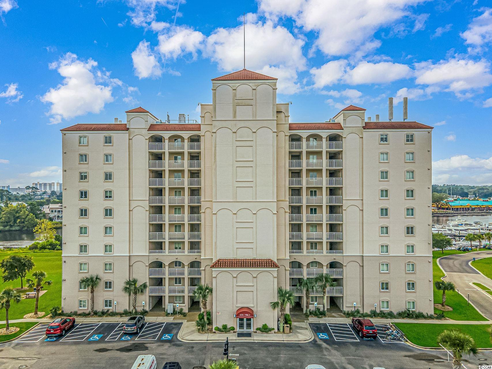 """Welcome to the best of North Myrtle Beach living. This beautiful unit located on the 8th floor of the Yacht Clubs Villas Number 2, has everything you would need plus breathtaking views. This unit is located directly on the waterway overlooking the marina and great tourist attraction of barefoot landing. Boasting 4 bedrooms and all with their own private bathrooms, this is truly privacy and luxury living at it's best. When arriving you will notice that there are three doors, the main entrance is through door """"A"""" leading you into a large open foyer that looks straight through the unit over the water. The other two exterior doors belong to the front two spare bedrooms, each equipped with private bathrooms with tile flooring and tub shower combo, ability to fit queen sized beds, carpeting, ceiling fans, spacious closets and yes their very own entrance and exits from the unit. Walking further into the unit you are meant with a a large kitchen featuring tile flooring, all white appliances that will convey, white cabinetry with solid surface, dark countertops, a breakfast bar, and plenty of storage. The dining area straight ahead, that can easily fit a 6 plus person table, is open to the rest of the huge living area, perfect for entertaining. The main living area is carpeting, with a ceiling fan and double sliding door access to a balcony overlooking the waterway/marina. Off the main living are the two largest bedrooms and bathrooms. To the right, this master bedroom has carpeting, ability to fit a king sized bed, a ceiling fan, access to its own balcony, large closet and full master bath with stand up shower, a garden tub, double sinks, tile flooring and a second entrance/exit leading to a hallway. This hallway has many storage closets and houses the stackable washer and dryer unit. To the left of the living area is the second master, with carpeting, a ceiling fan, the ability to fit a king sized bed, its own private balcony as well, and a master bath with similar feature"""