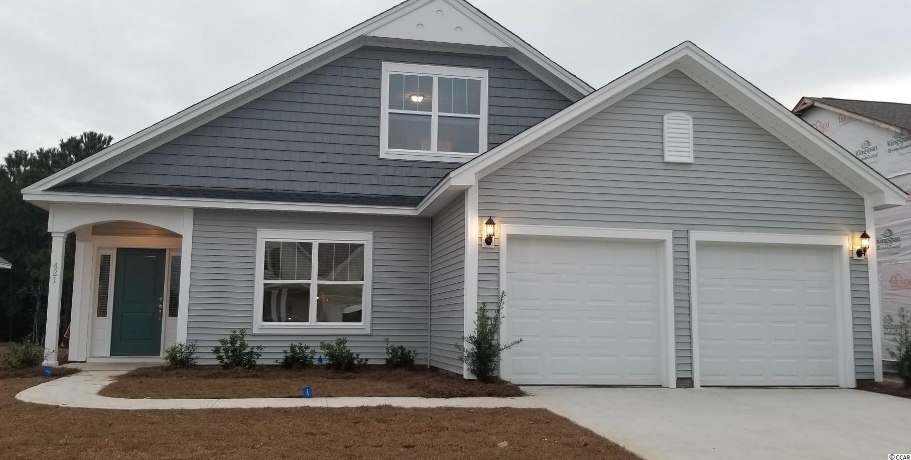 """This Jensen is under roof and in drywall tentatively completing in late December.   Located within the International Club golf course community in Murrell's Inlet, you'll be central to everything you need and close to so much that you'll want to go and do!! Enjoy life living near the beach, The Marsh Walk, Brookgreen Gardens and several golf courses in this well appointed, affordable home in Murrell's Inlet. Evans Park is so conveniently located within the International Club making it just a few minutes to 3 grocery stores, 5-10 minutes to oodles of restaurants, 10 minutes to Garden City beach and the Marsh Walk with tons of food and great music!!   The Jensen 2 story home is so open and airy! Walk into your 23' long family room with decorative painted beams across the ceiling! Walk under the wide arch enter your spacious kitchen. Your expansive island with furniture like legs is terrific for cooking and entertaining! Walk out to your included 16' x 10' covered rear porch now opens up the outdoor living for you too!! We have added the porch fireplace with full height stone surround for extended use in the cooler months! Primary Suite is tucked down the hall on the main floor!! Ceramic tiled floor and separate vanities in your bathroom! We've added the 60"""" x 42"""" tiled shower walls for added luxury!  We've added the office with French glass doors at the front of the home so you can work from home!! But you could hang a chandelier in there and use it as your formal dining room or whatever you want it to be!! With the 2483 Heated sq ft, you'll have plenty of room to entertain in the large family room, spacious kitchen and dining area! Two bedrooms upstairs and a full bath plus a loft in between would be a private area for family or guests or a great work out area! Extra storage under the staircase for all of that extra stuff we have. The kitchen will feature the new renovation TV popular charcoal colored Shaker Style cabinets with white quartz counter tops and white til"""