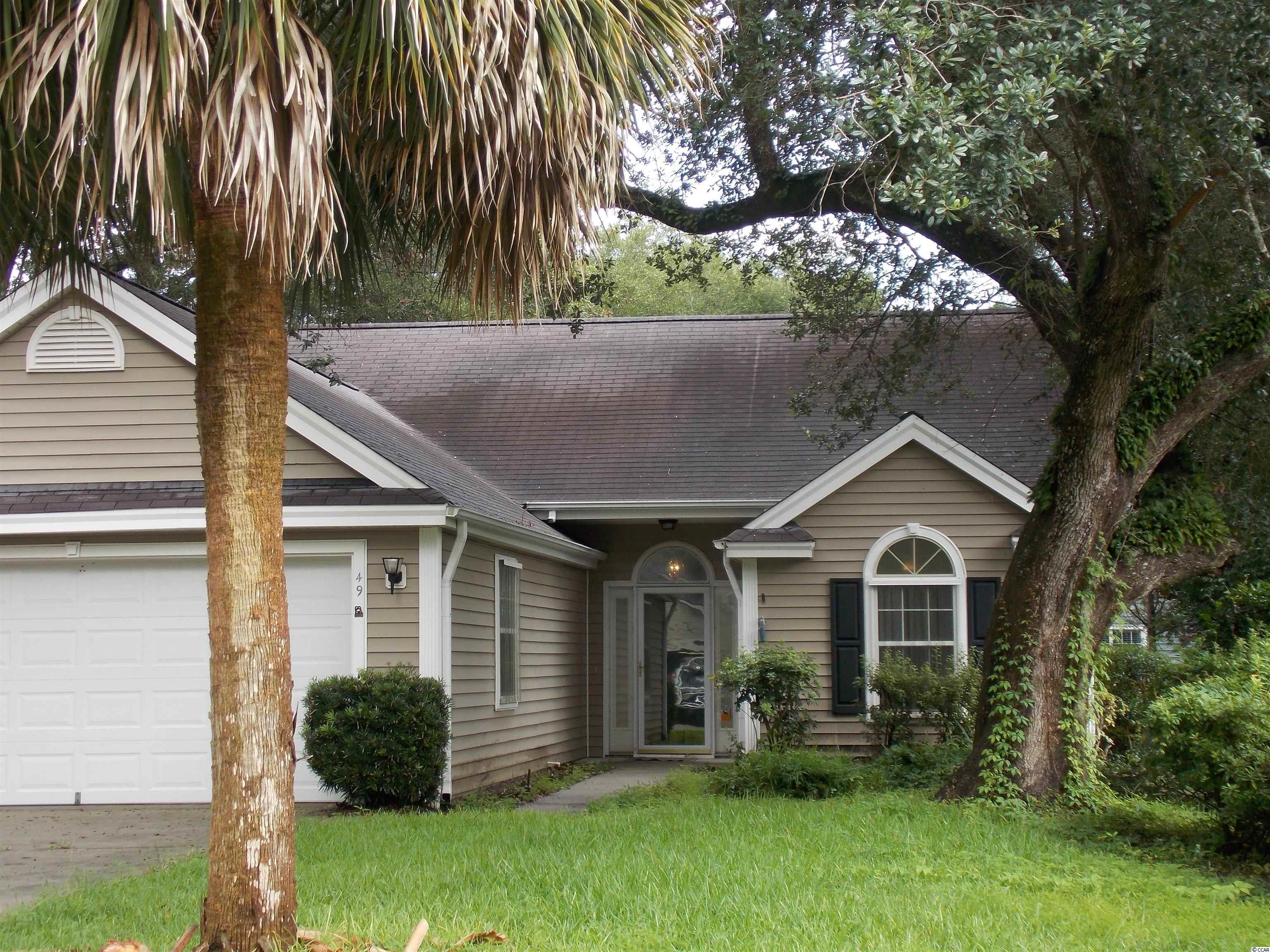 This Pawley's Island Beauty is 1694 square feet of bright living space with storage galore.  Counted there are nine closets plus a pull down attic.  Off of the spacious family Room is a formal dining room and kitchen with breakfast nook.  Through the family room and French doors is a true Carolina Room, surrounded by windows, tiled floor and a separate ductless HVAC unit.  Every window in the house has clear polycarbonate hurricane panels allowing the interior to stay light and bright.  The mature landscaping includes ancient oaks, palm and magnolias.  Location is ideal with the home East of Hwy 17 and 3 minutes or 1.2 miles from Pawley's Historic District and the beach!