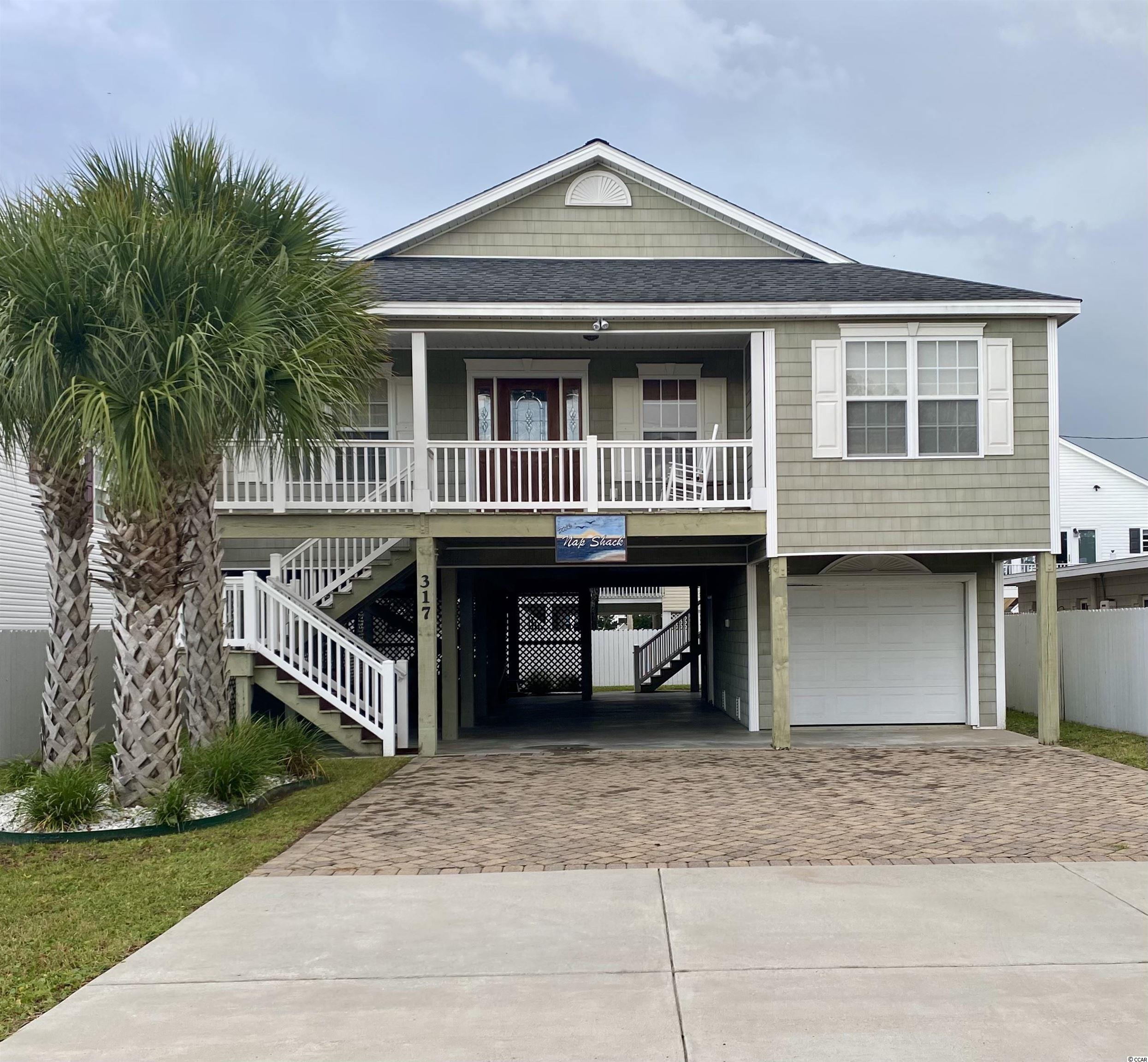 Gorgeous, raised beach home in the Prime Cherry Grove section of North Myrtle Beach. This amazingly maintained 4br /3 bth home has Cove ceiling in the den that offers a spacious open feel to the home. With hardwood floors throughout the Den/ kitchen area. Kitchen has been upgraded with custom cabinets and Quartz countertops, all stainless-steel appliances with beautiful apron sink. The back covered porch is located off the kitchen area and is perfect for just sitting and relaxing. Enjoy the downstairs outdoor living area that is perfect for beach living at its best, plenty of room for grilling and enjoying the beach breeze, including outdoor shower to enjoy after a long day on the beach. Garage offers ample storage for beach items, Golf Cart parking and more. Classic coastal landscaping with nice back yard area. Home comes fully furnished and ready to enjoy.  The home's location is perfect, with a very short walk to the ocean and walking distance to grocery store, popular restaurants and the Cherry Grove Pier. The home has been a second home and seller is the original owner. It's turn key ready for you to enjoy as your primary home, 2nd Beach home or prime rental property.