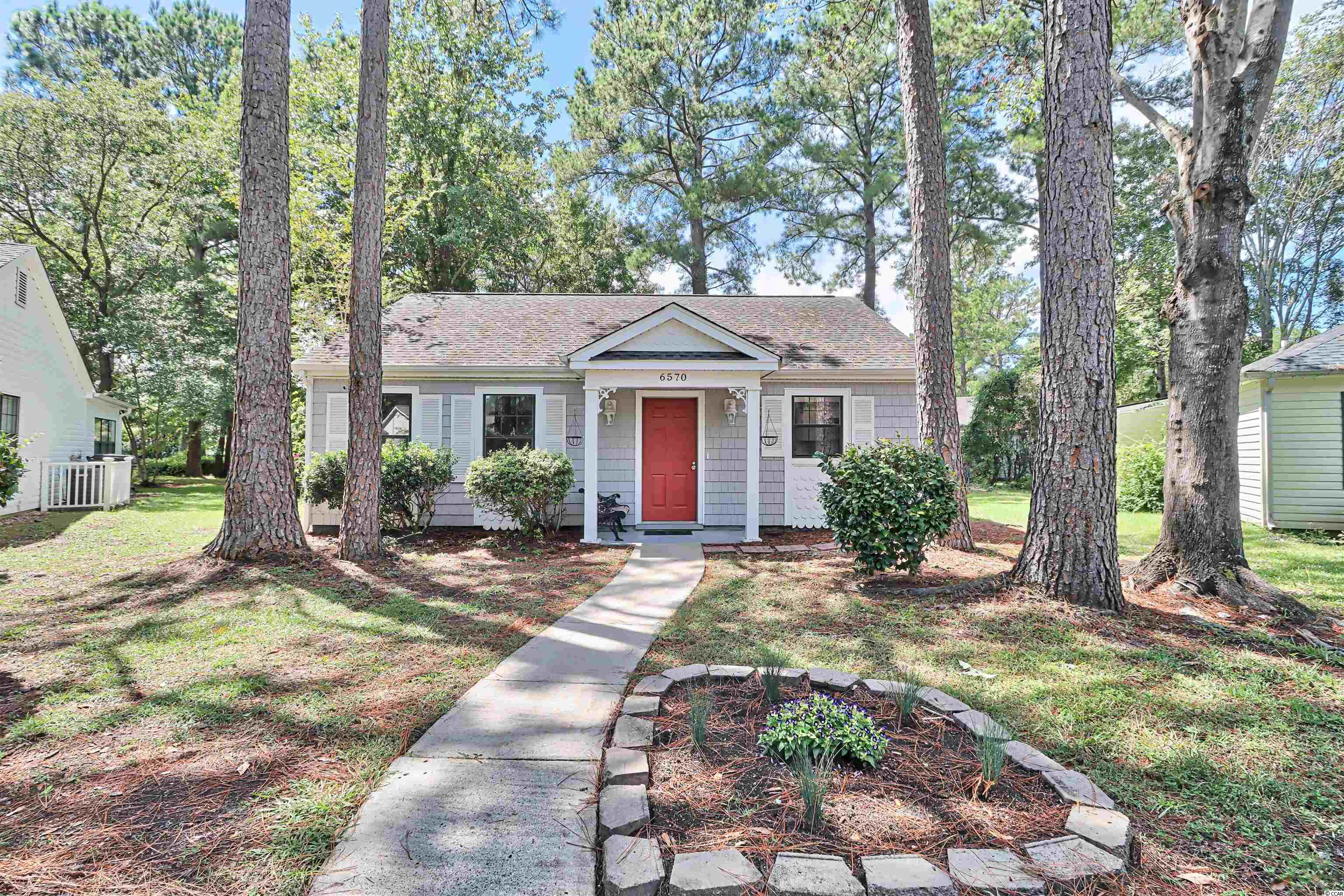 Come see this newly renovated home located in the Myrtle Beach Golf and Yacht community. This two bedroom and two bathroom home features new Luxury Vinyl Plank flooring and fresh paint with newly finished ceilings throughout.  The kitchen has been completely updated with white shaker cabinets, stainless steel appliances, and granite counters tops which include a lowered bar.  The living room leads to the newly conditioned Carolina Room giving that extra living area everyone enjoys.  Both bedrooms have newly installed ceiling fans and nice closet space.  Both bathrooms include newly installed toilets and a new vanity in the master bath with extra storage.  Enjoy your outside time on your rear patio and use your two built in storage rooms to store those gardening tools.  Myrtle Beach Golf & Yacht offers 24/7 security at the entrance gate, community pool, hot tub, play ground, and picnic area as well as additional community activities. All of this is just minutes to beaches, the Intracoastal Waterway, golf courses, shopping, dining, the Murrells Inlet Boardwalk and other great area attractions.