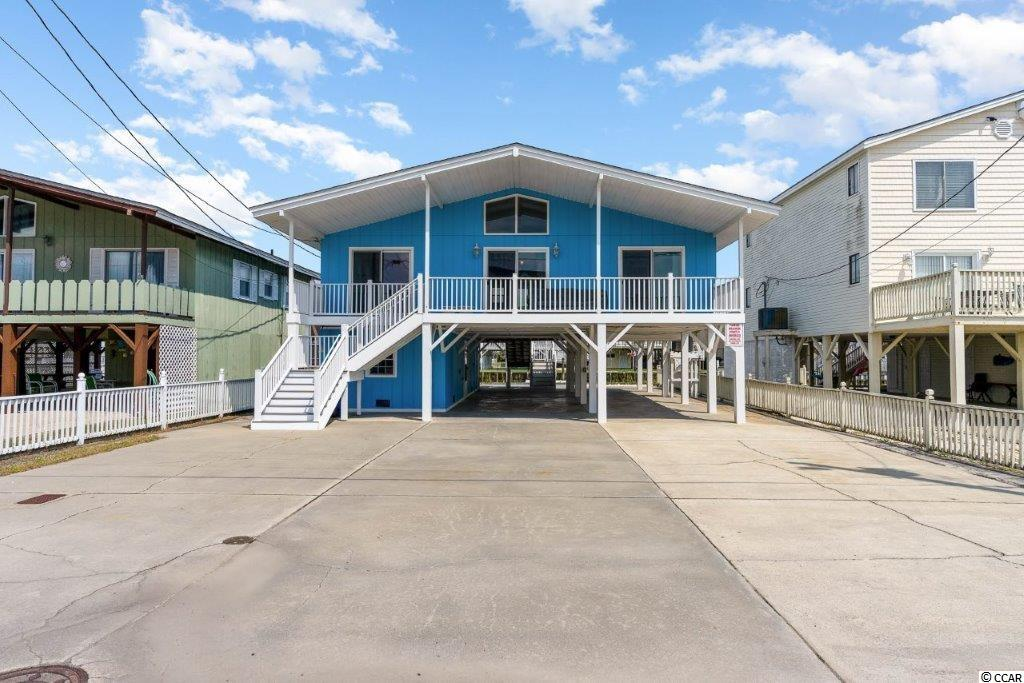 Unbelievable value for this Cherry Grove Channel home with quick access to the beautiful blue Atlantic. If you've been waiting for a move in ready beach house this is the one for you.  This home has been completely re-done inside, including All new electrical wiring, new panels upstairs and downstairs, outlets, light fixtures, counters, cabinets, appliances, water heater, you name it, it's been done for you.  The HVAC units are less than 2 years old and the roof is approximately 4 years old.  Upstairs you have a wide open floor plan with vaulted ceilings, living area and modern kitchen that has gleaming quartz counters, tile backsplash, stainless appliances and new lighting and fans.  There are 4 bedrooms set up Jack and Jill style with brand new baths in between each.   Downstairs you'll find an incredible 1 bedroom suite with kitchenette that includes a refrigerator, range, microwave sink and breakfast area along with a full bathroom with shower and windows for plenty of natural light.  When you're at the beach you spend time outside and this home offers plenty of outdoor living space for your enjoyment with spacious front and back decks and brand new composite decking boards, a wonderful porch swing out back overlooking the channel and a large outdoor shower perfect for rinsing off after a day at the beach.   310 58th is a short walk to the beach with beach access at the end of the road.