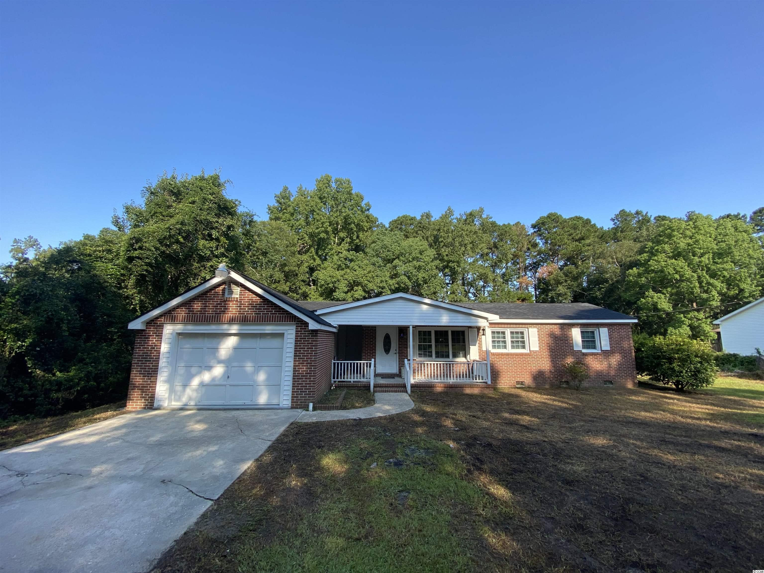 Four bedroom 2 bath plan ranch with updated kitchen. Oversized one car garage. Outside city limits and a fenced in yard.