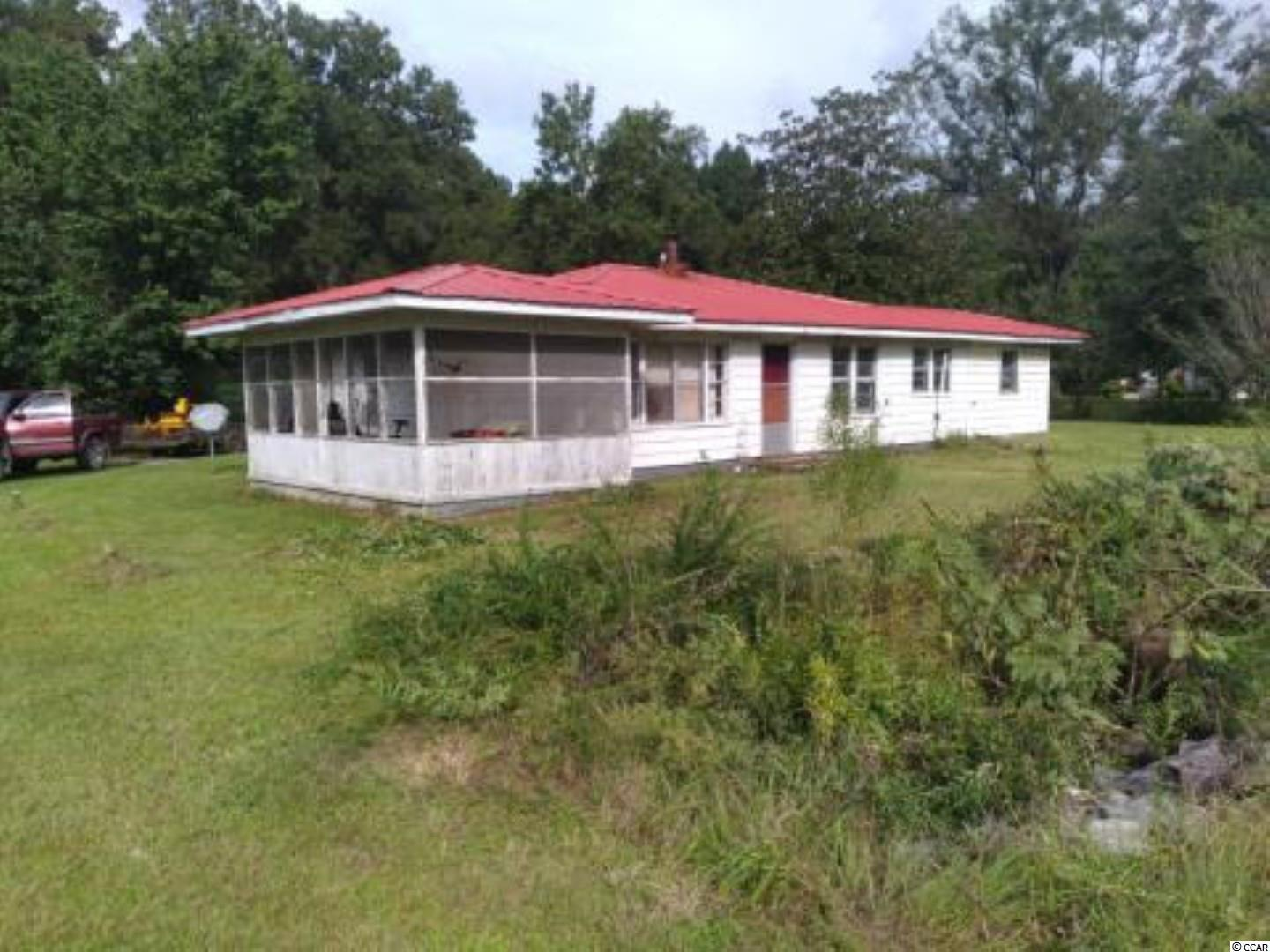 Here is a 3 Bedroom 1 Bathroom home to acquire as a potential flip opportunity or for someone who would like to remodel and use for themselves. Located on a very private 1.8 Acres close to Georgetown and Andrews. The owner had a new metal roof installed in 2014, this home is solidly built and has good bones. Property is Zoned General Commercial which allows for most any use. List of Permitted Uses for General Commercial is available.