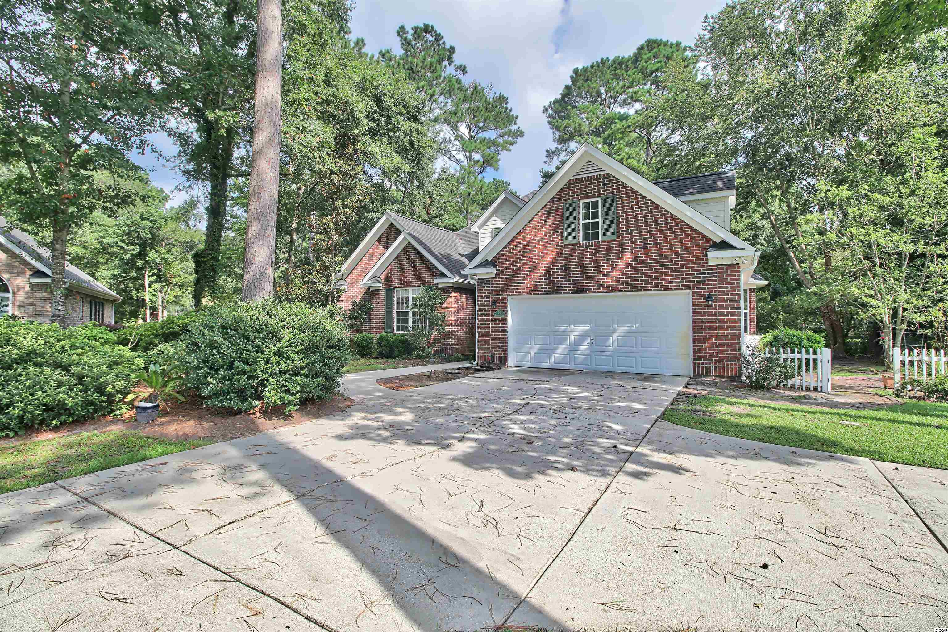 Welcome to 54 Millbranch Lane, located in the gated golf community of River Club.  This four bedroom, two and a half bath brick home is situated on a quiet cul-de-sac.  As you enter the generous foyer, the inviting living room offers a gas burning fireplace, hardwood floors and an abundance of natural light.  The openness of the formal dining area to the living room creates an ideal entertaining space. Accommodations of the kitchen include a breakfast nook, pantry, and ample countertop space and cabinets.  The master bedroom suite and walk in closet are located on the ground floor with 2 additional bedrooms, a shared bathroom, and a powder room.  The fourth bedroom can be found upstairs and would make the perfect home office or playroom. Take the bike path that connects River Club to all the amenities Litchfield by the Sea offers!  HOA fee includes access to oversized community pool, security, plus use of Litchfield by the Sea's clubhouse, fishing docks, walking trails, tennis courts, and pools.