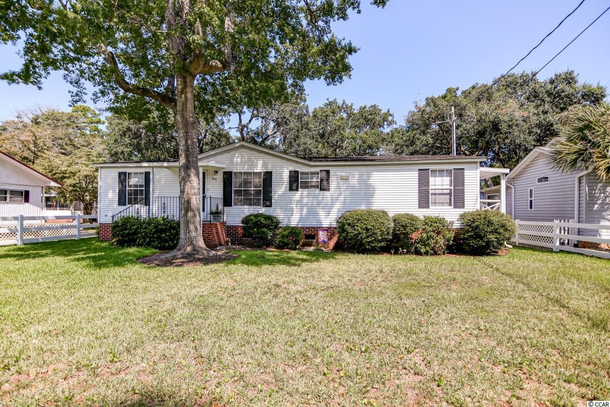 AMAZING LOCATION! This fabulous 3 bedroom 3 bath home is located just a 1/2  mile from the ocean! The home sits on a nice corner lot and has been lovingly maintained, making it a perfect primary home or vacation home! It is also being sold fully furnished so you can start enjoying your new beach home right away! The mostly open floor plan is functional and roomy. The kitchen has a breakfast bar and breakfast nook plus there is a larger dining area adjacent to the kitchen as well. In the kitchen you will also notice there is plenty of cabinet and counter space as well as a pantry for extra storage! The large master bedroom has a big ensuite bathroom with double sinks, glass enclosed walk-in shower, and a vanity mirror. The split floor plan keeps the master bedroom separate from the other two bedrooms and the second full bath. This home also has a separate laundry room as well. Another amazing feature of this home is the massive screened in back porch, that can be accessed through sliding glass doors in the living room! There is also a front porch and side porch as well! Outside there is a detached storage shed perfect for storing all your beach chairs and toys! After you get home from a long day on the beach you can even shower off at the outdoor shower so you don't have to worry about tracking sand inside! Come see this terrific home just a golf cart ride from the beach today!
