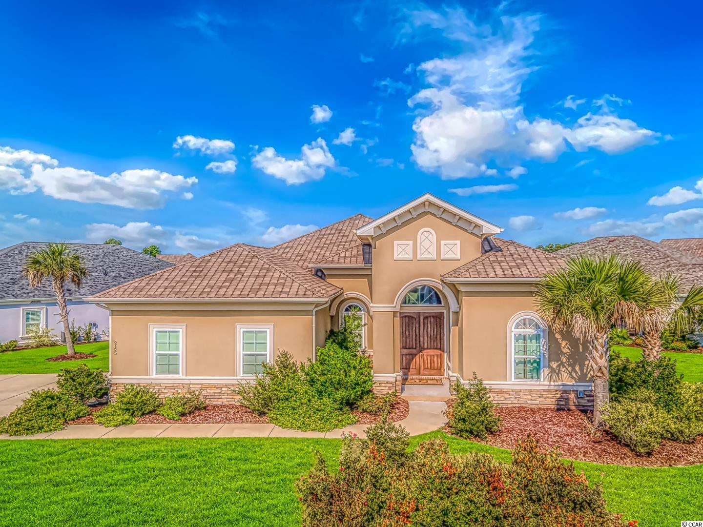 **Largest lot in Tuscan Sands, check out the drone view** This gorgeous custom-built Mediterranean style home is located in the highly desirable community, Tuscan Sands, in Barefoot Resort.  This one level floor plan offers 4 spacious bedrooms and 3 full bathrooms. When you enter the large double front door you are brought into the foyer which features a tray ceiling with a height of 14 ft. You will notice luxury hardwood floors throughout the main living areas and master bedroom. There is a designated formal dining room with a tray ceiling that is perfect for gatherings. The main living space is an open floor-plan with plenty of natural light and full access to the upgraded kitchen. This state-of-the-art kitchen features granite counters, classic tile black-splash, stainless steel appliances including a double wall oven, a cook top with a hood. The kitchen cabinets are upgraded maple linen with crown molding and soft close drawers. Just imagine cooking your favorite gourmet meal here! The master bathroom is exquisite with tile, a large walk-in shower, relaxation tub, double vanities with granite counter tops, and double walk-in closets. Oil rubbed bronze lighting and hardware throughout the home, along with more tray ceilings, and ceiling fans. Plantation shutters and window treatments will convey with this home. Enjoy evenings out on the patio sipping your favorite cocktail. No expense was spared in the construction of this home, book your showing today!