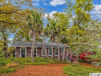 Little slice of paradise!  This 2 bedroom home is located just over the NC/SC line in Little River, SC.  Community has loads of recreational activities.  Community pool is located at the end of the road.  Community backs up to the Intracoastal Waterway.  Vereen Gardens is located right next to the community as well.  Walk inside and you'll notice the open floor plan.  Built in shelving and brick flooring.  Kitchen is completely updated with glass top stove, stainless steel appliances, granite counter tops and updated cabinets.  Outside is an oversized deck with fenced in area.  Pergola and mature landscaping with large oak trees and palms.  1st bathroom has black and white tile and a stand up shower.  2nd Bathroom has a soaker tub and an updated vanity with bowl sink.  Master bedroom is the great size for a queen bed.  Contact your Realtor to see this great home today!