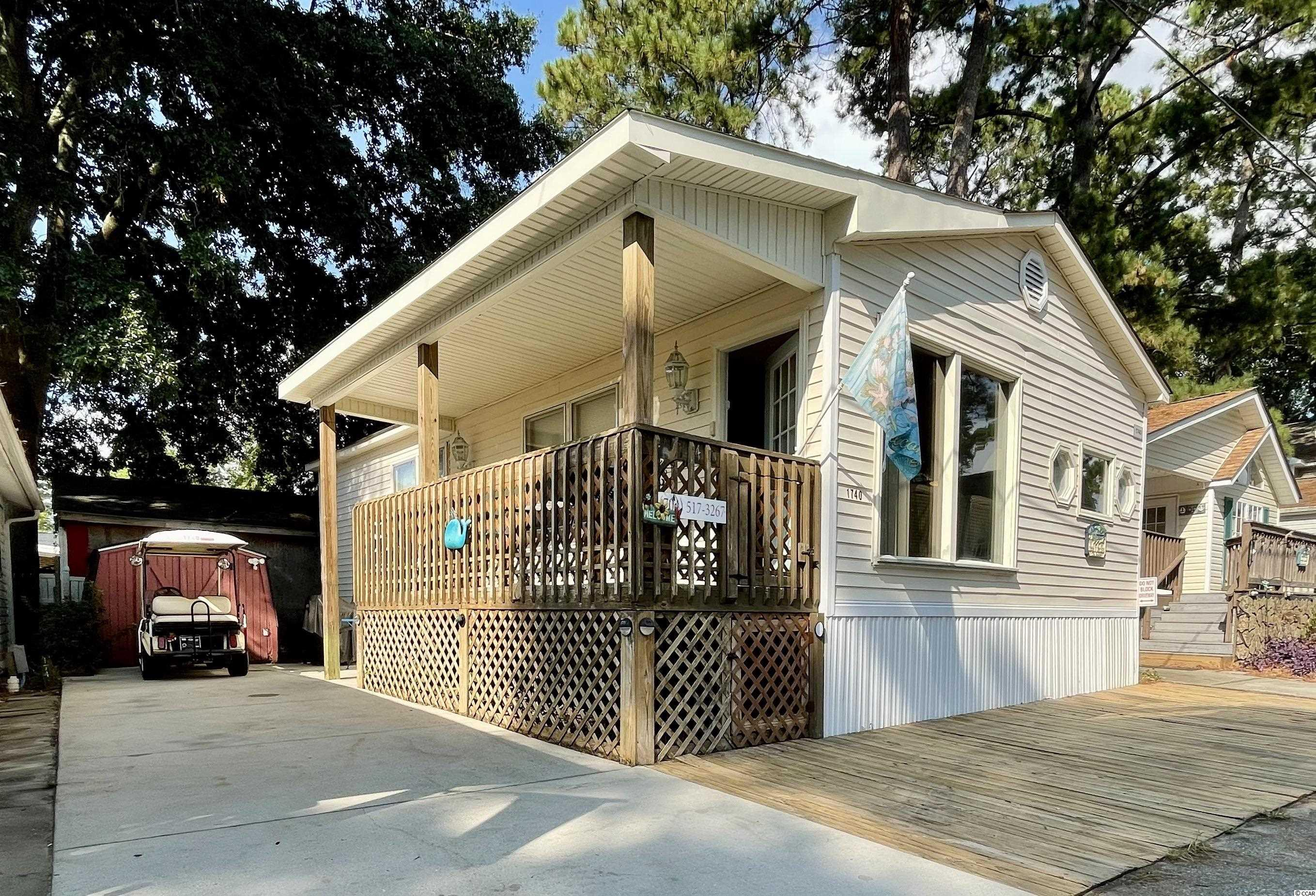 JUST LISTED IS A GREAT LITTLE 2 BED/2 BATH BEACH HOUSE WITH NEW HVAC, STAINLESS STEEL APPLIANCES, NEW FLOORING IN KITCHEN, GUEST BEDROOM AND BATH AND A MASTER BEDROOM WITH HUGE ENSUITE IN OCEAN LAKES! Large open floor plan with plenty of gathering space for the entire family. A covered porch and paved driveway offer great outdoor beach living. This home is being sold fully furnished including all furnishings, decor, appliances, washer/dryer (in master bath) and golf cart! Must honor 2021 rentals. Now showing!  There is no HOA in Ocean Lakes however, all permanent home sites are located on leased land, which are payed in semiannual installments due in January and July.   Amenities abound in Ocean Lakes' gated community and include almost a mile of pristine white sand beach, 24 hour security, trash pick-up, free cable TV, indoor/outdoor swimming pools, water park/slides, lazy river, splash zone, 2 full size basketball courts, miniature golf, fire pit, corn hole, shuffle board, horseshoes, ping-pong, Sandy's Down-under skatepark, recreation building, arcade, general store, golf cart rentals, Sandys Meet & Eat restaurant and more!