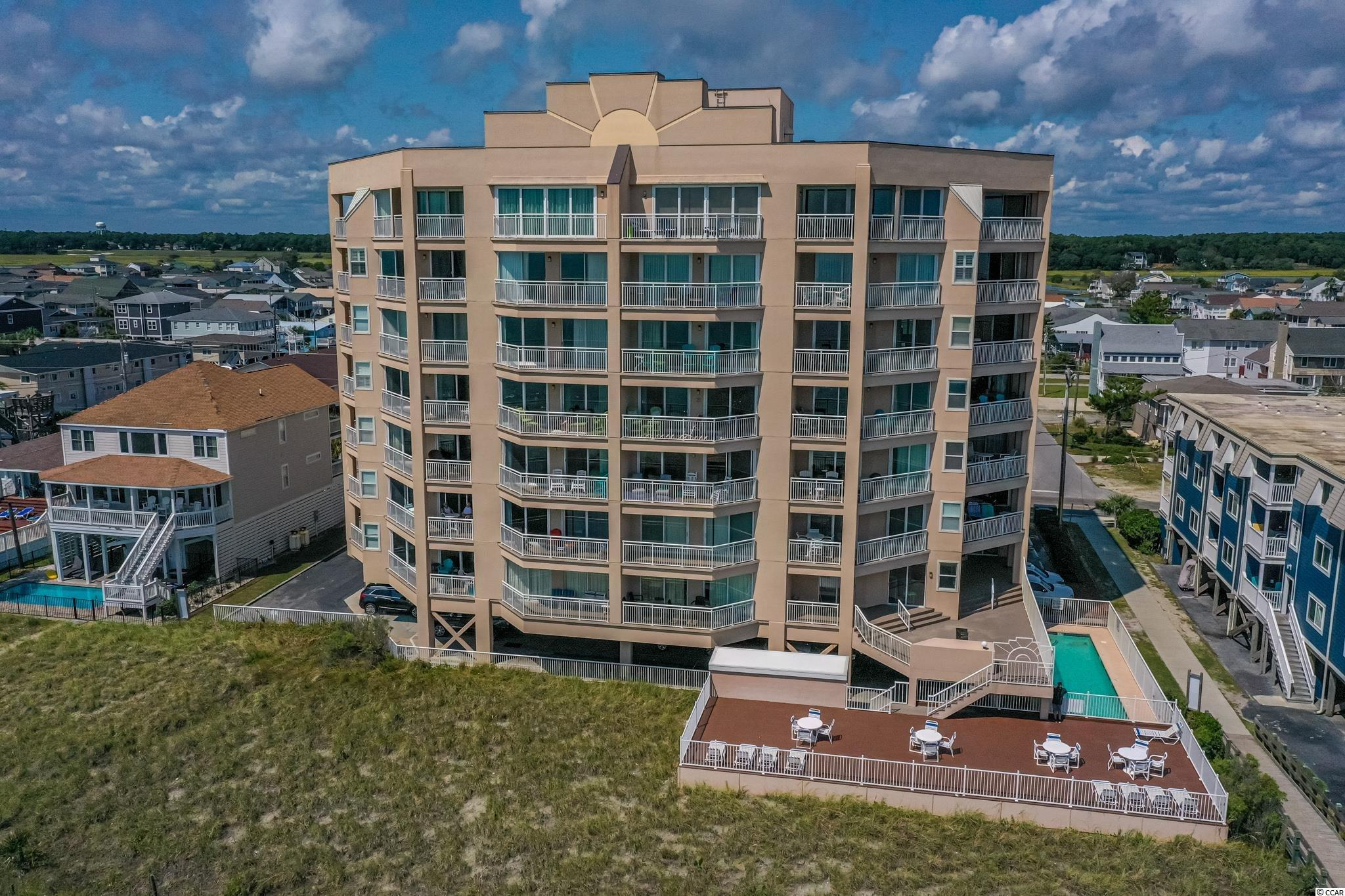 Gorgeous two bedroom, two bath, oceanfront condo at Hyperion Towers in North Myrtle Beach. The towers offer underneath parking, secure key pad entrance, elevators, pool, deck area, grilling area, fitness center, lounge, and private beach access. Tile flooring throughout, new paint, updated bathroom vanities,  and updated furniture for a more beachy feel. Kitchen boasts white cabinets, granite counters, backsplash, updated lighting, stainless steel appliances, and breakfast bar with wainscoting. The primary suite has beautiful ocean and pier views from two picture windows, access to the broad private balcony through slider, large closet, and a private bathroom with double vanity, new raised toilet, and shower tub combo. The spacious dining room, living room combo has a rustic table and chandelier, ceiling fan, slider access to the balcony, and grand views of the beach. Sitting on the balcony you will get breath taking 180 degree views of the beach, pier, and also the sunrise in the morning. Other features include full size washer and dryer, newer HVAC (2019), newer roof (2019), attached storage, updated bathrooms, new exterior building paint, and much more. Square footage is approximate and not guaranteed, buyer is responsible for verification.