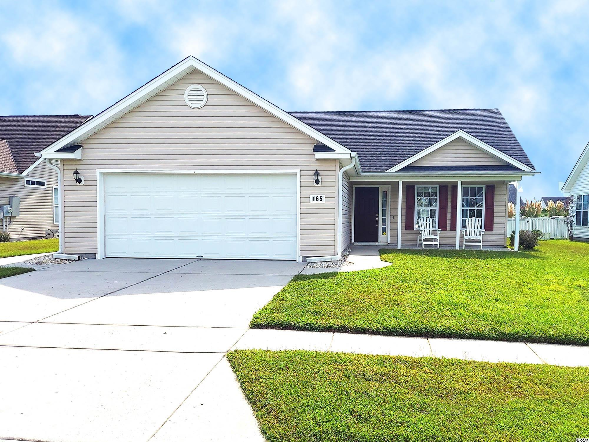Barely used as a second home and in immaculate condition, this 3 bedroom/2 bathroom home is a short golf cart ride to Surfside Beach. The home features a 2-car garage and large screened-in porch with privacy in the back yard. All TVs, refrigerator, washer, dryer and dishwasher convey with sale.