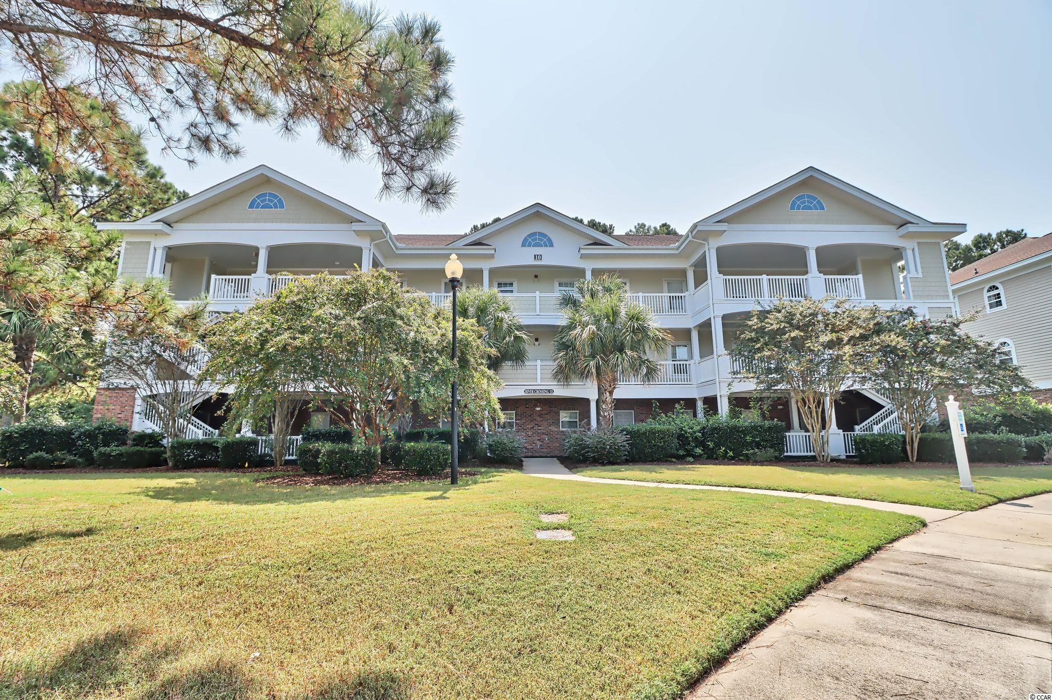 1st FLOOR END UNIT condo located in the gated community of River Crossing at Barefoot Resort, just three miles to the beautiful beach and Atlantic Ocean! Lovely 2BR/2BA with lots of natural light and a cozy screened patio with tile floor and attached storage closet to house all of your beach gear.  Never rented, the seller has used this unit as a second home only.  Both the HVAC and hot water heater were replaced in 2018.  New refrigerator installed August 2021.  Come and enjoy the Barefoot lifestyle. Low HOA fees include all utilities except, electric in the unit and HO6 insurance (interior). Amenities include multiple pools, designated parking lots at the beach and use of a brand new beach front cabana, currently being built.  Barefoot is also home to four championship golf courses, driving range, plus two restaurants/bars. Why not make it your home as well!!