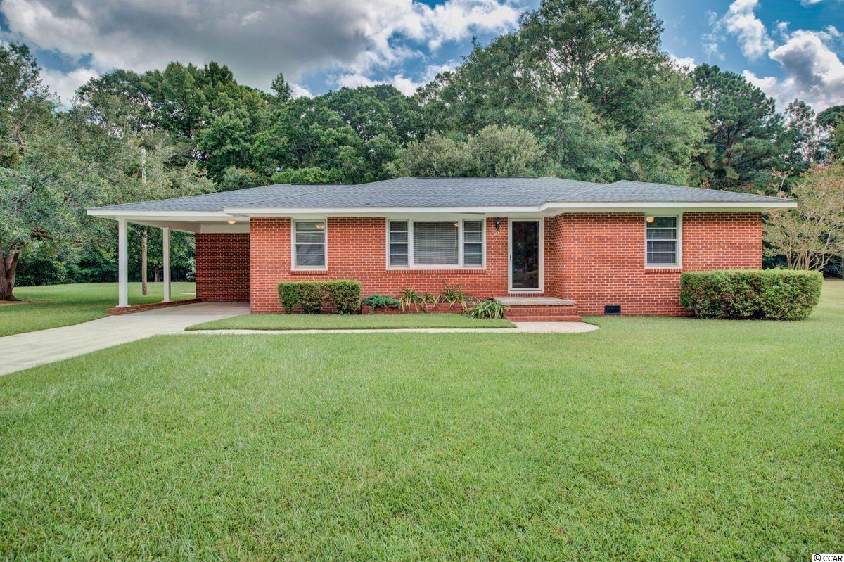 This three bed, two bath, ranch style brick home is located minutes from the heart of Historic Georgetown. With heart pine walls and extra large lot, the opportunities for growth or rental potential are outstanding. A storage shed is also located on the rear of the property.