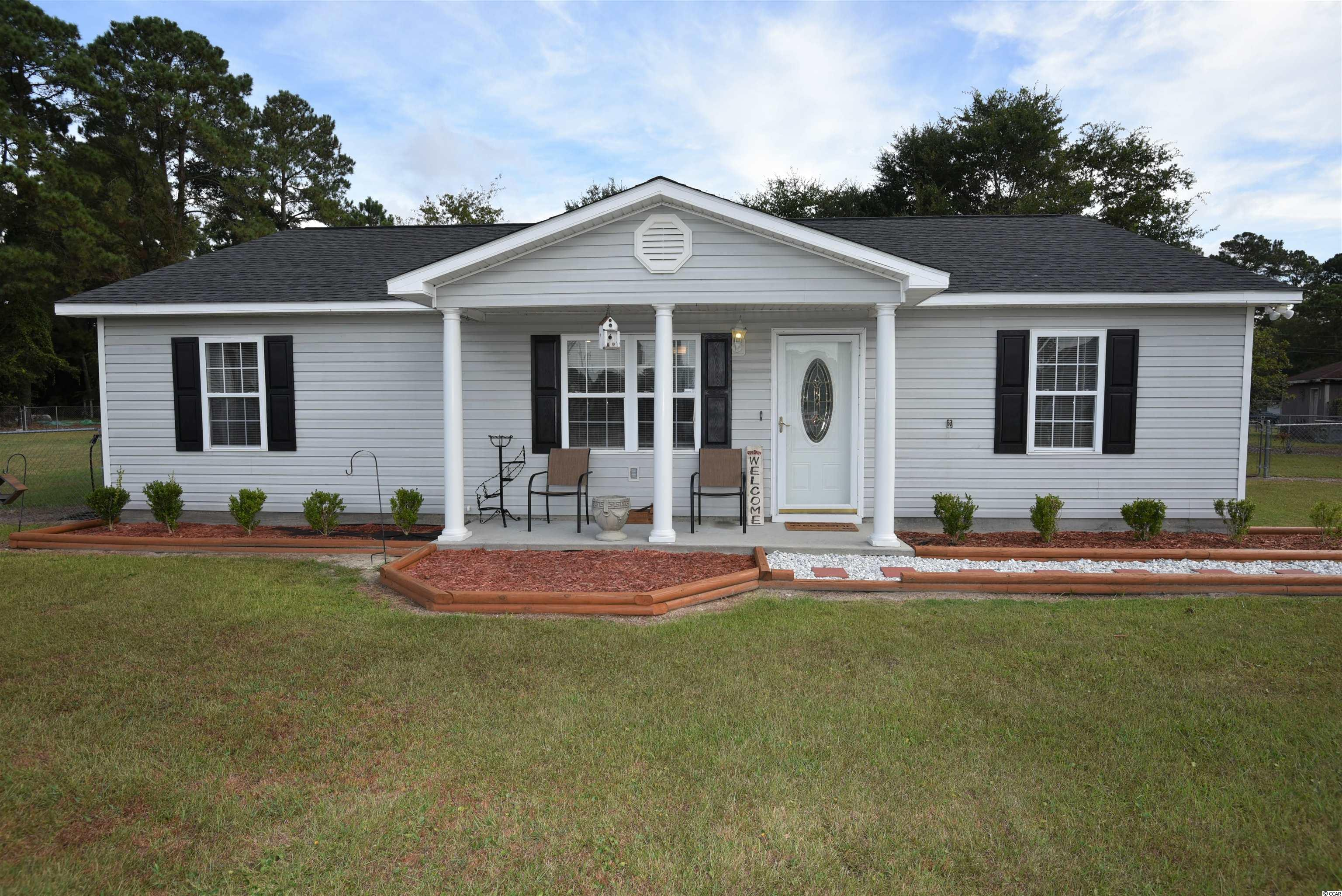 A must see, this 4 bedroom, 2 full bath has been freshly painted and upgraded.  Immaculate inside and move in ready.  Beautiful, fenced in lot at the end of a quiet, dead end street is a perfect spot for young families or people with pets.  Conveniently located, this home is located just 10 minutes from the beach at Cherry Grove and minutes from the areas many golf courses and local restaurants.