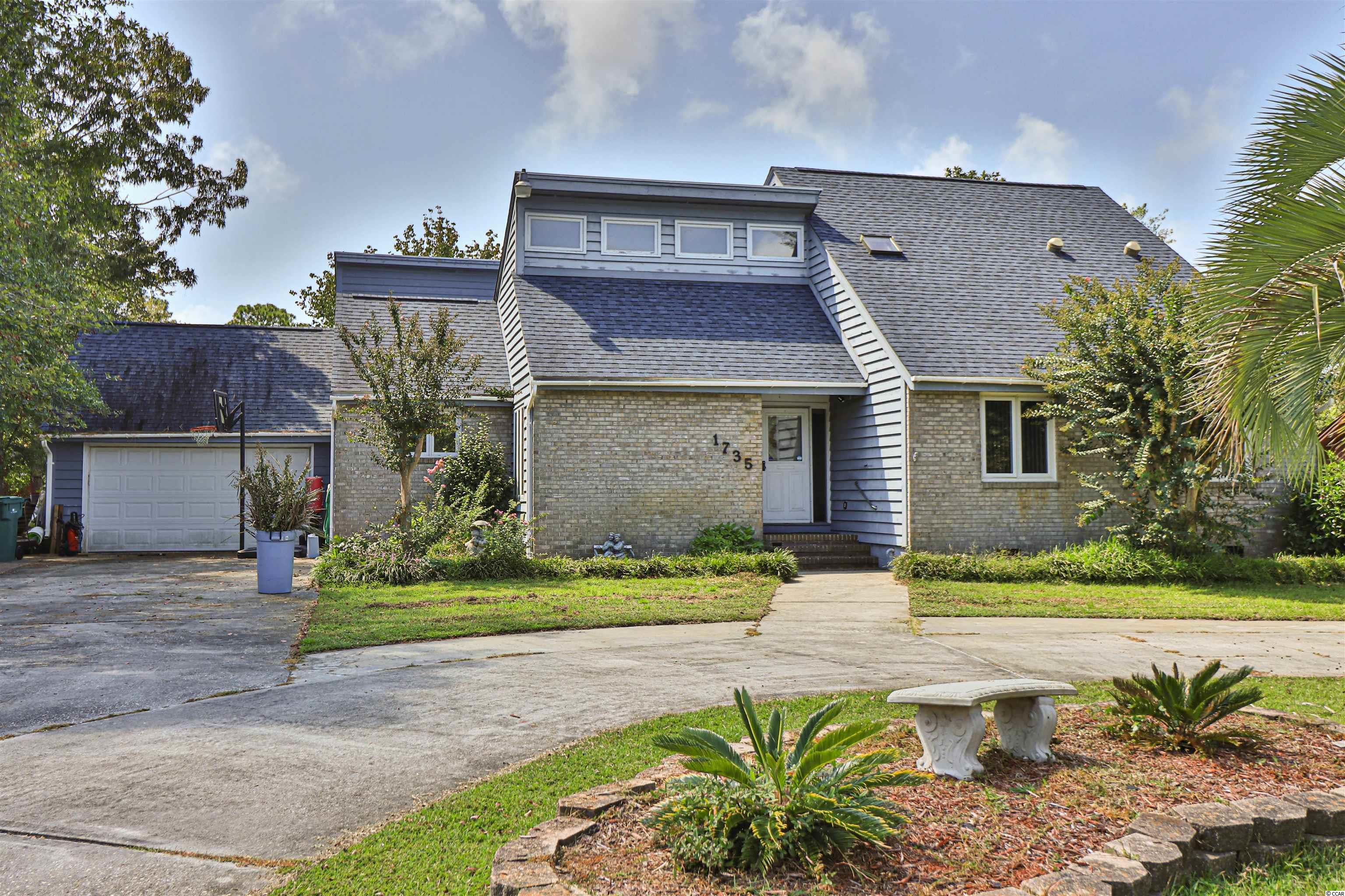 Don't miss out on this incredible opportunity! This beautiful 4 bedroom, 3.5 bathroom family home located in the wonderful neighborhood Deerfield Plantation features a bright and spacious floor plan! The vaulted living room features beautiful wood beams and a gorgeous brick fireplace plus a formal dining room! The newly renovated kitchen features lovely white cabinetry, custom backsplash, plenty of counter space, stainless steel appliances, a double oven, a pantry, and a large breakfast nook! The comfortable master suite boasts access to a private balcony, a large walk-in closet, and an impressive master bathroom! This amazing home also features a stunning Carolina room lined with wall to wall windows! You will enjoy the spectacular weather and huge backyard perfect for grilling out and entertaining! Being in such a great location, you are only minutes to the beach, The Pier at Garden City, Market Commons, delicious restaurants, shops, and so much more! Book your showing today!