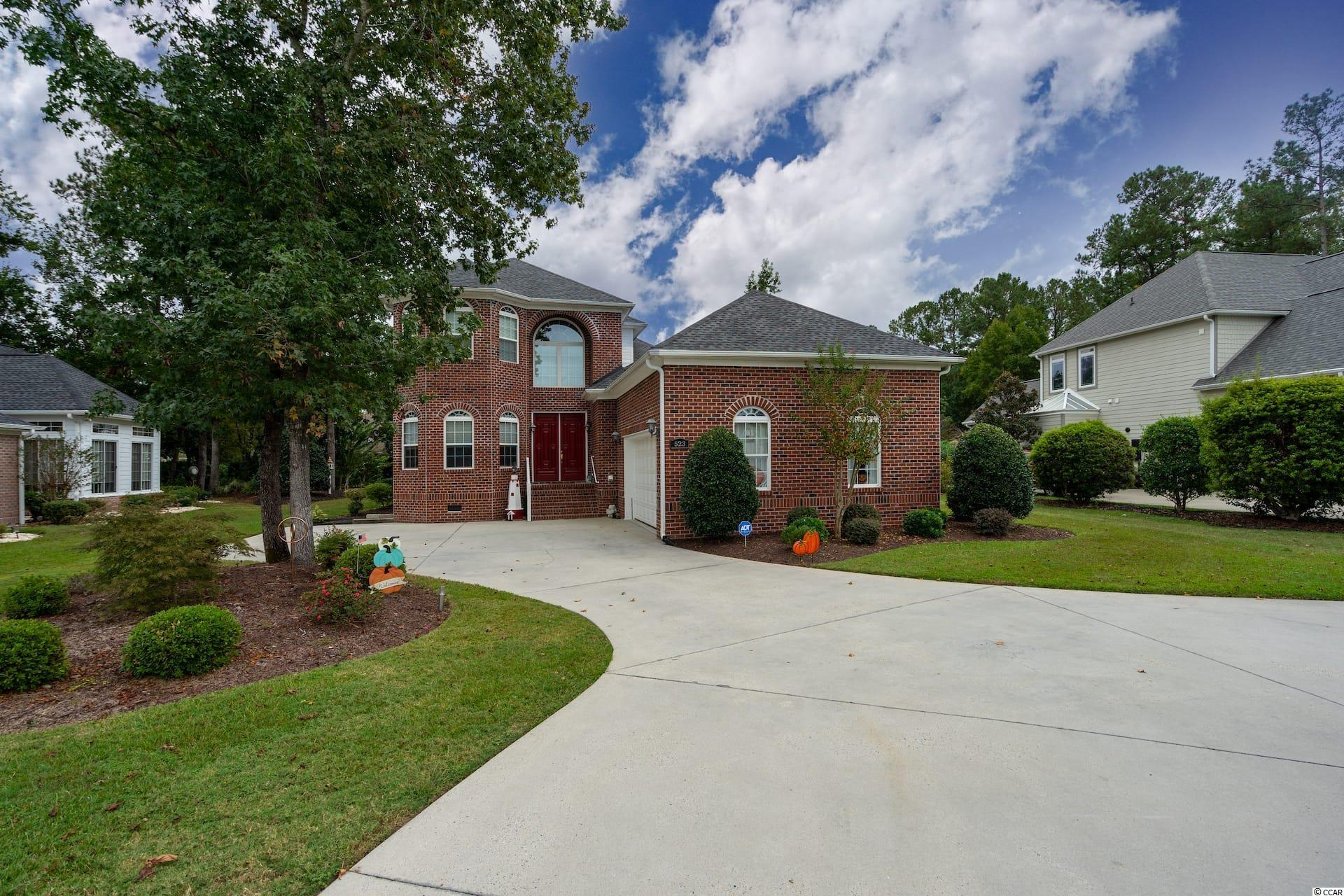 This MOVE IN READY, beautiful all brick home is located in the community of Long Bay, home of the prestigious Long Bay Golf Club, a signature Jack Nicklaus course.  Upon entering the home you are greeted with a lovely open foyer and stairway that leads to the second floor.  The entry floor has recently been updated with a beautiful wood look tile and pebble stone border, and the family room, kitchen, dining room, hall and master have also been updated with LVP flooring.  The family room is open above with windows that allow for lots of natural light  The owner's suite is located on the first floor along with one guest bedroom and bath.  The 3rd bedroom is upstairs along with a charming loft area that overlooks the family room below, perfect for a home office or separate relaxing area to give your out of town guests their own space.  There are porches that have EZE Breeze window systems on both levels with ceiling fans.  The garage comes with overhead storage systems and storage cabinets.  There is a side entry garage for your golf cart and the crawl space has been completely encapsulated with a floating barrier system, sump pumps, dehumidifiers and flooring insulation.  Nothing has been left to chance in this extraordinarily well maintained home.