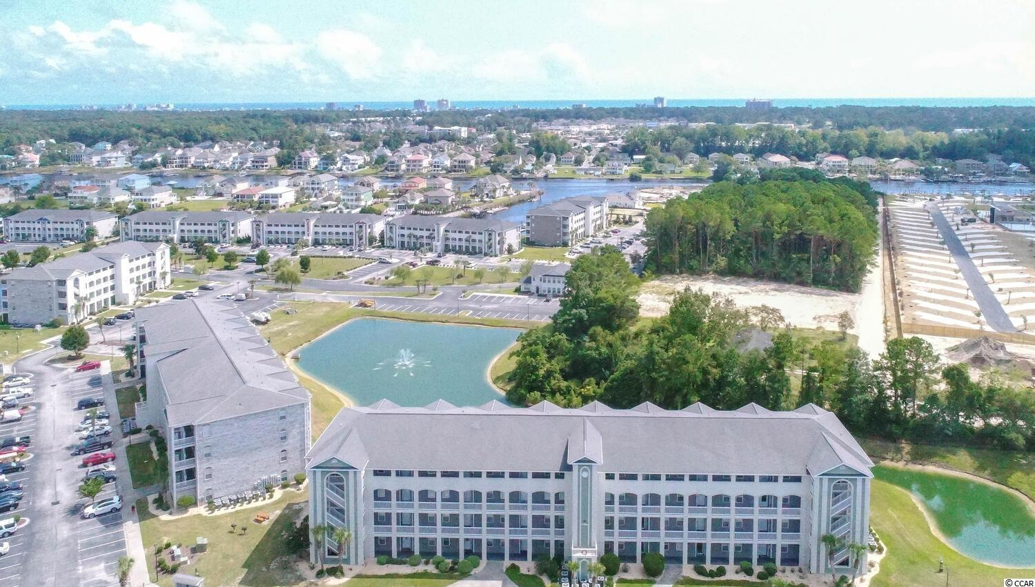 This is a beautifully appointed 3BR 2 BA condo in the Carolina Yacht Landing subdivision.  This is a gated community with roaming security and camera monitoring for the owners safety and security.  This community has 2 pools a clubhouse with weight room, and both community day docks and docks available for annual rental for residents only.  The community also has parking areas for both boats and trailers, making this a true mariners dream.  This condo has matching stainless steel appliances and all appliances convey including the washer and dryer.   The lighting in the unit has been updated and the flooring in the unit is vinyl plank flooring in the entry, living space and kitchen.  The bedrooms are carpeted and in need of TLC.  The living space is dramatic and lives large with a large bay window in the living area bringing the outside in.  Closets galore exist in this condo with two closets in the Master bedroom, one of which is walk in. The master bedroom is large and easily will accommodate a king size bed and large furniture, and has direct access from the master to the screened porch.   The master bedroom suite has a shower in the large bathroom.  This is a must see condominium in a unique waterfront community in Little River South Carolina.  This community is a short drive to the beach and golf carts are allowed, for easy access to the beach and nearby shopping in North Myrtle Beach.  Carolina Yacht Landing is close to many dining and shopping areas and in the community famous for the Crab and Shrimp Fest yearly.  Privacy, the beach and boating all close by in this beautifully maintained community.