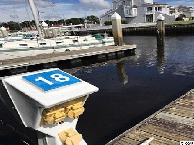40' deeded boat slip in charming Mariner's Pointe in Little River.  Unique slip because cleated docks are on both sides, enabling maximum tie down and boat security. Small gated private marina/condo community with 116 individually deeded boat slips and 146 separately deeded condos.  Basic cable to slip.  Electric metered separately.   Internet available.  Showers, clubhouse, bar, pool, hot tub, basketball, pickle ball, and tennis courts.  Close proximity and easy access to the Atlantic Ocean (no bridges).  Historic Little River fishing village just blocks away with restaurants, shopping, and fishing!  Golf and entertainment nearby.  Just minutes to the beach!  Measurements are approximate and not guaranteed.  Buyer is responsible for verification.