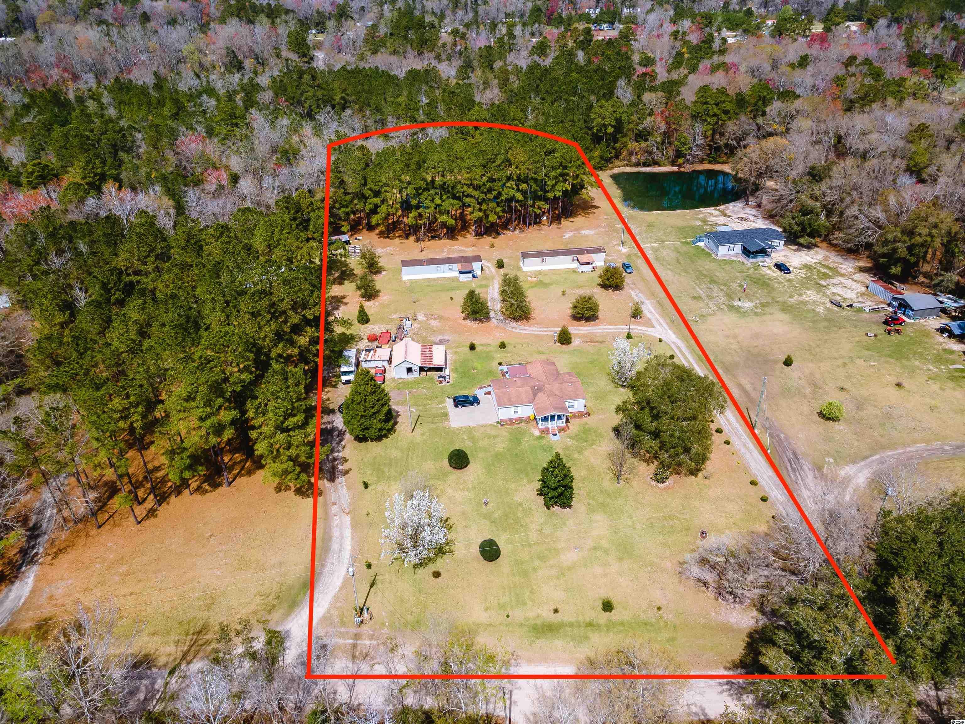 With no HOA or restrictions, this countryside setting is the perfect investment! This beautiful property hosts three manufactured homes, outside storage buildings, and a fully stocked pond for the price of one! You could rent them all, or live in the double wide and rent out the 2 properties in the back. The choice is yours! It is just 15 minutes from downtown Conway and 35 minutes from Myrtle Beach. Call today for more information on this investment.