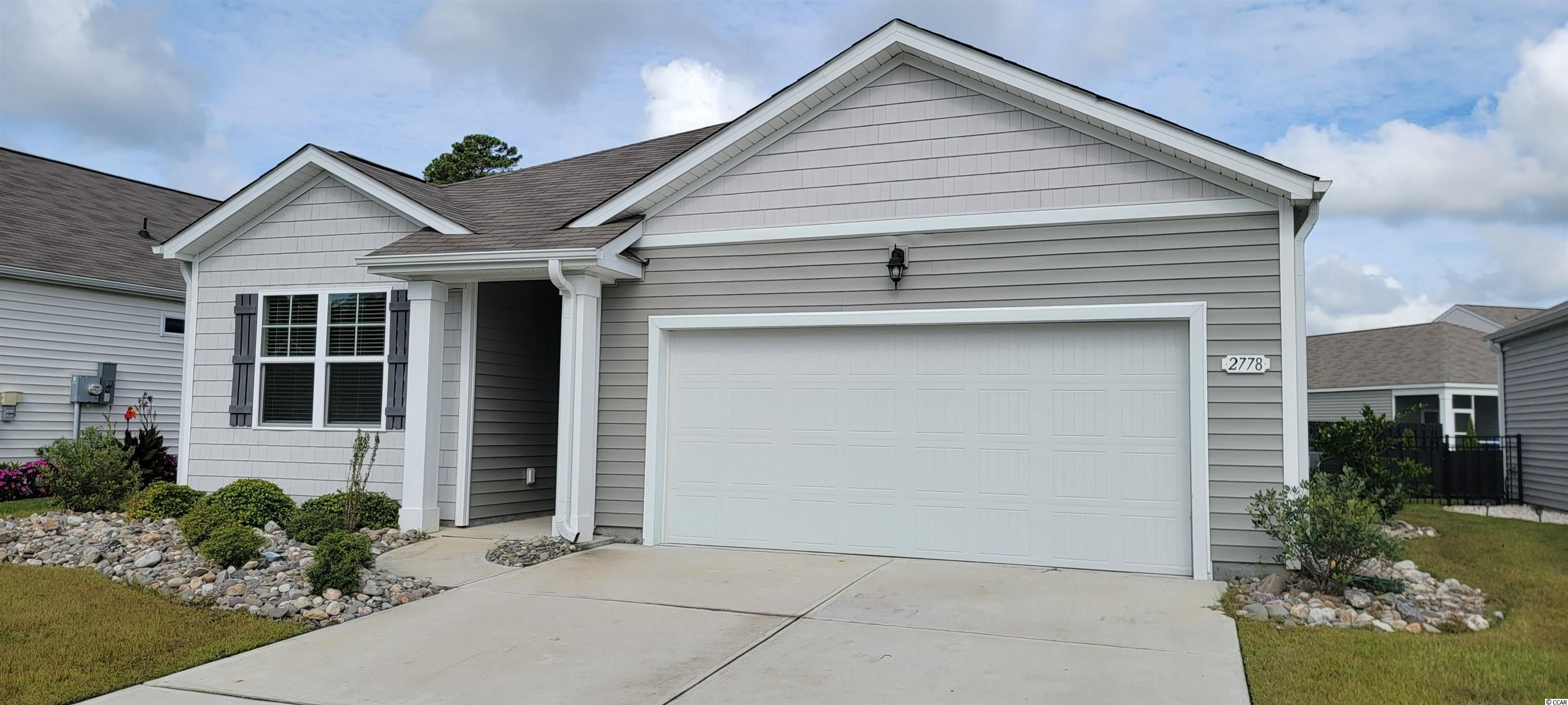 """This """"SMART HOME"""" is connected! Lock or unlock your doors, control the temperature of your home and see who is ringing your doorbell, from your smart phone! Kitchen features stainless appliances (including refrigerator) and 36"""" cabinets with pendant lights over the granite counter-height island, all overlooking the spacious living room and dining room- great for entertaining! Low maintenance solid surface flooring (resilient hardwood-look vinyl) throughout the living area, bathrooms and laundry room. From the dining room, sliding glass doors take you to a 12 x 8 ft. covered porch. Owner's suite offers a large walk-in closet and bath with 5 ft. shower, double vanity and sinks. Washer, dryer and garage door opener also included! We are the price-leader for single family homes in Market Common! Our home owners will enjoy a gracious pool and hot tub, air conditioned pickle ball court/meeting space, walking trails and a short golf cart ride to the beach. Live like you're on vacation! (Home and community information, including pricing, included features, terms, availability and amenities, are subject to change prior to sale at any time without notice or obligation. Square footages are approximate. Pictures, photographs, colors, features, and sizes are for illustration purposes only and will vary from the homes as built."""
