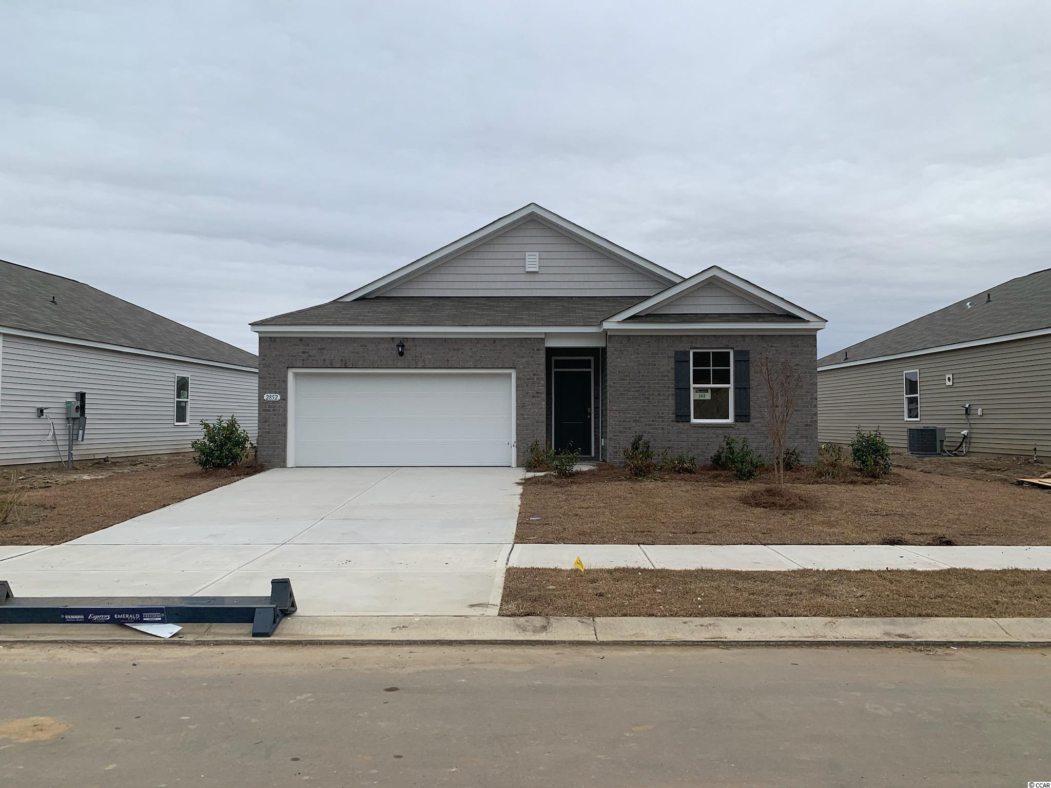 New phase now selling at Meridian! The Kerry offers one level living at its best! Featuring an open concept design with 9 ft. ceilings and plenty of room for entertaining. The spacious kitchen offers white painted cabinets, granite countertops, a large island with breakfast bar, and stainless Whirlpool appliances. Tons of closet storage and a large laundry room! The private primary bedroom suite has a walk-in closet and en suite bath with a dual vanity and 5 ft. shower. Covered rear porch for additional outdoor living space overlooking the pond. Conveniences like low maintenance laminate wood flooring throughout the main living areas, a tankless gas water heater, two-car garage with a garage door opener, and our industry leading smart home technology package will also be included! Enjoy wonderful amenities and a fantastic location just minutes away from shopping, dining, and the beach! *Photos are of a similar Kerry home. (Home and community information, including pricing, included features, terms, availability and amenities, are subject to change prior to sale at any time without notice or obligation. Square footages are approximate. Pictures, photographs, colors, features, and sizes are for illustration purposes only and will vary from the homes as built. Equal housing opportunity builder.)