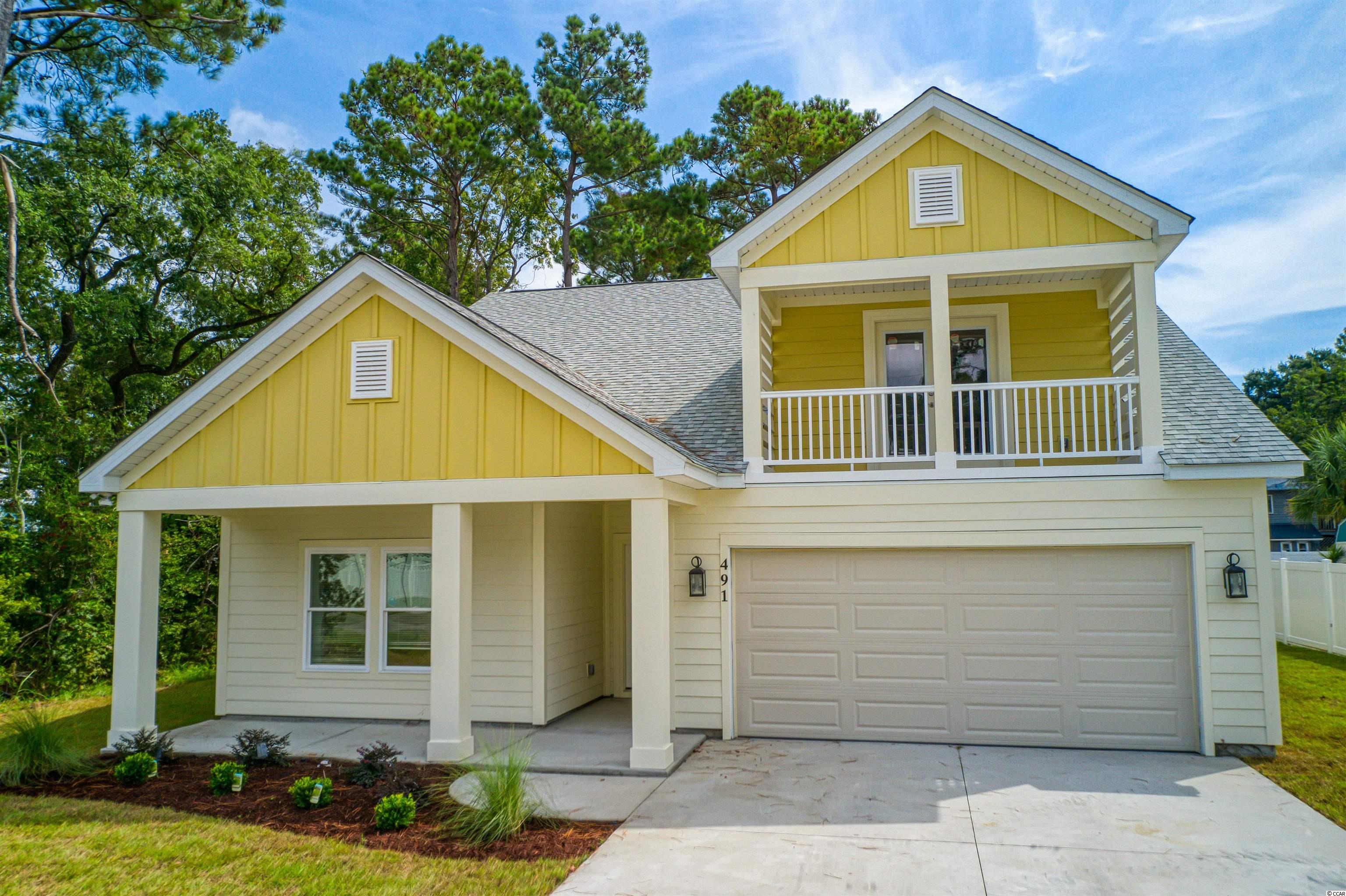 Rare Opportunity to Live East of 17 with a Short Golf Cart ride to Beautiful Pawleys Island Beach in a nice community with NO HOA fees. 491 Minnow Drive is a Like New 4 BR 2 Bath Split Level Home with a nice sized newly sodded yard that can easily hold a pool out back. You will love the LVP flooring, Oversized baseboards, Ceiling Fans, Beautiful White Kitchen Cabinets, New Granite Counters, and Stainless Steel Appliances. Family friendly Floor Plan with 3 BR's down and a Spacious Bonus Room/Man Cave over the garage with a nice Balcony view to enjoy the upcoming Fall Sunsets.  Big Dining room, Laundry room and Tray Ceiling in the Master BR. Big Screened in Back porch and 2 Car Garage. Convenient to everything- Dining, Grocery stores and Great restaurants! You make memories for a lifetime with ll the Opportunities to quickly enjoy everything Beautiful Pawleys Island has to offer; Creek fishing, crabbing and boating! Kayaking, Paddleboarding, surfing and of course the Beach! Take a morning run or bike ride and 7 Golf Courses are within 3 miles. Best of all no HOA's in this quiet community! This one won't last long so don't delay and grab your piece of Pawleys today!