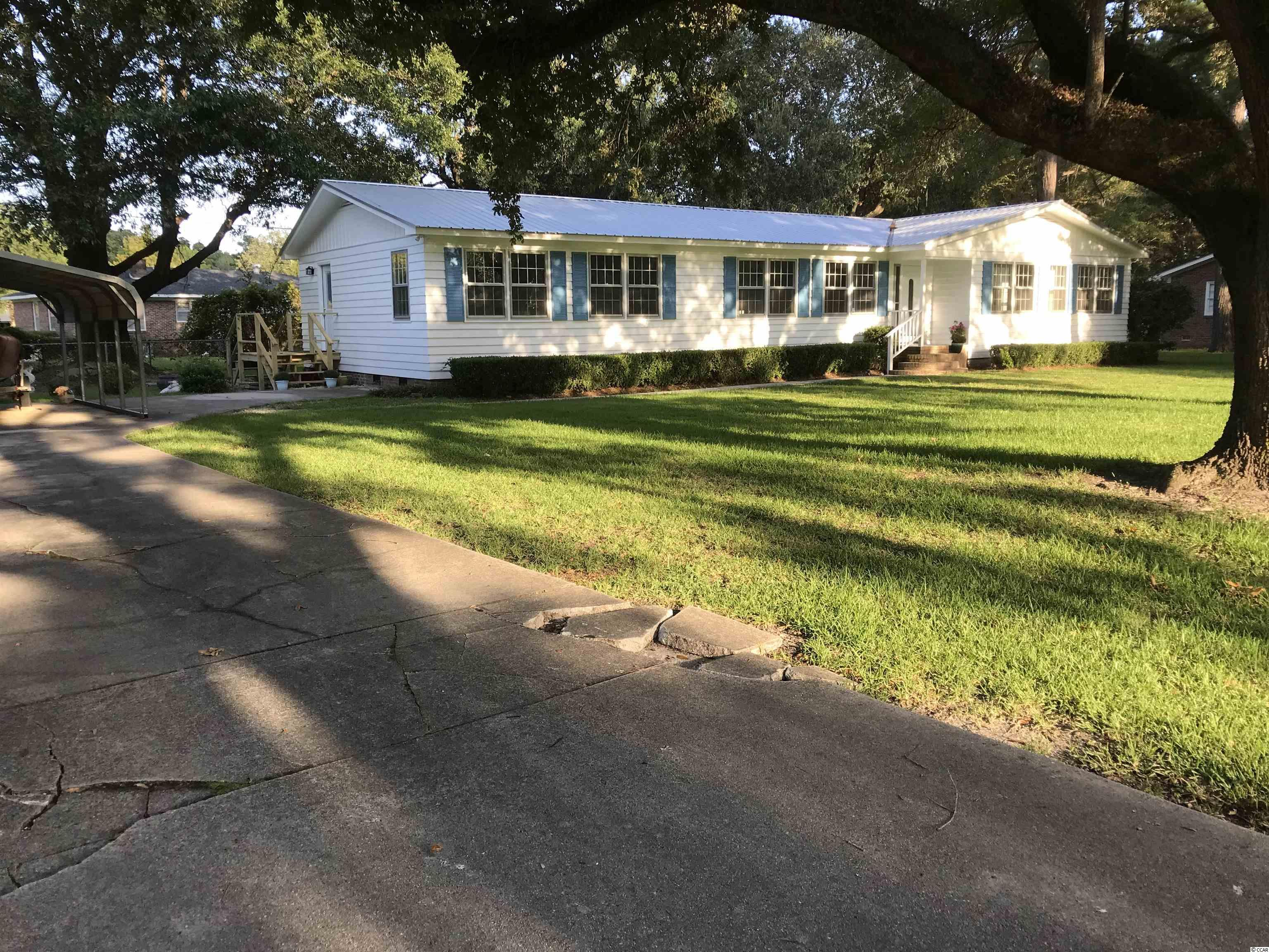 Absolutely beautiful remodeled home on an oversized lot with majestic live oak trees in a quiet neighborhood with no HOA.    Close to all schools, stores and downtown Historic Georgetown.  And just 20 minutes away from the beach. Home has 2 large primary suites, all new electrical wiring; new plumbing; new roof; screened porch; and appliances convey.  (New washer & dryer to be installed.)  Can go on and on about how great this house is but you will have to see it yourself to know.