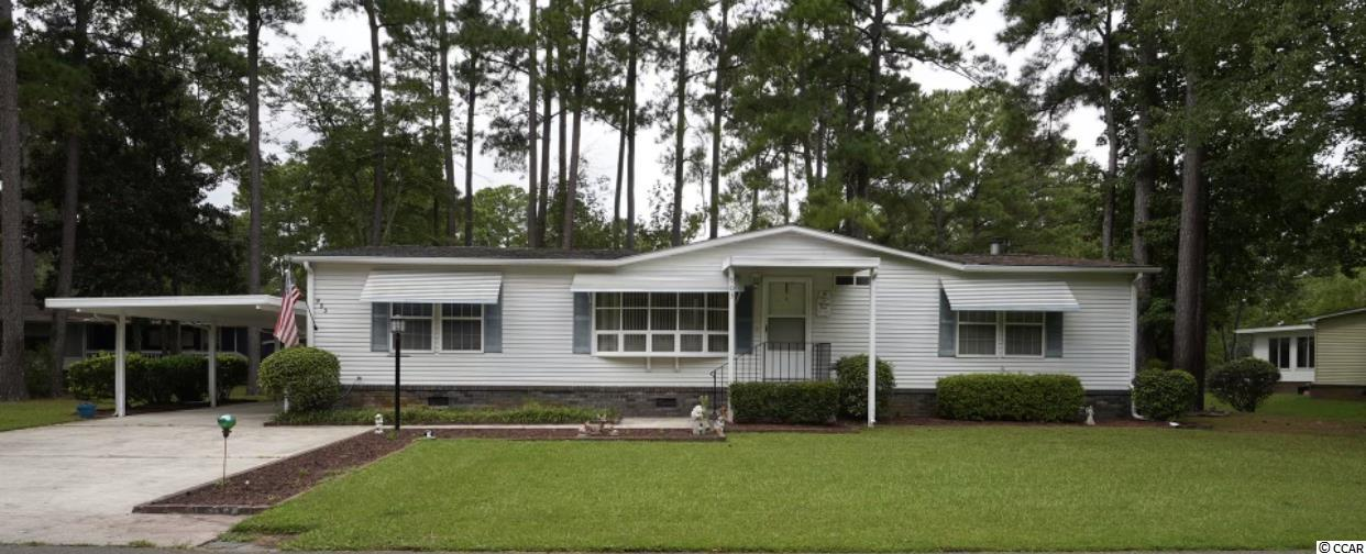 This lovely turnkey home is located in the 55+ Ocean Pines Community, just a short golf cart ride to the beach and close to shopping, fine dining and local attractions such as the Marsh Walk.  This well maintained property is move in ready and boasts a double patio off the back of the home.  One of the patios is screened in, the other open to the lovely back yard overlooking a large pond with dock.  Large sunny kitchen with ample cabinet space, formal dining room and family room with a wood burning fireplace make for a very cozy living area. Master bedroom with private bath includes a walk in shower.  Split floor plan gives a 2nd bedroom and bath on the opposite side of the home allowing for privacy. Sliding doors in the dining room and family room offer direct access to the outside patios. Large driveway with carport offers parking for 4+ cars.  Outside storage shed can be used for storage or workspace. This home is move in ready and will not last long!