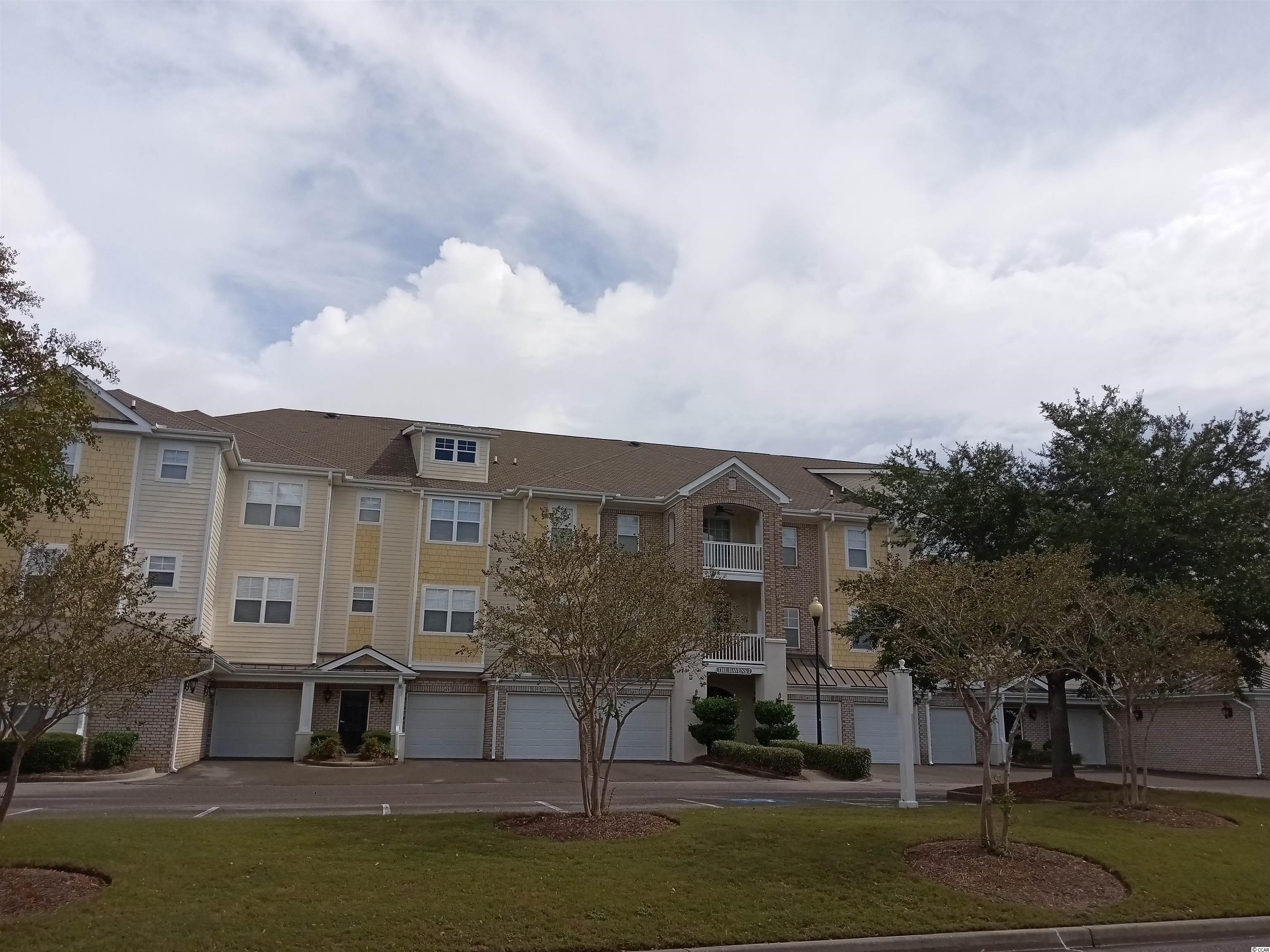 Welcome to this beautiful 3 bedroom 2 bath end unit condo in The Havens.  The unit is very roomy and comes with a one car garage.  The living room and bedrooms have laminate flooring and kitchen and baths are tile.  The balcony offers privacy with the trees and a peak of #11 tee box of the Greg Norman Golf Course.  The building has secured entry and elevator.  The swimming pool and outdoor grills are a short walk away.  Barefoot Resort has four championship golf courses, a large practice facility, restaurants and a private oceanfront cabana with private parking for owners.  This one is a beauty so come take a peak!